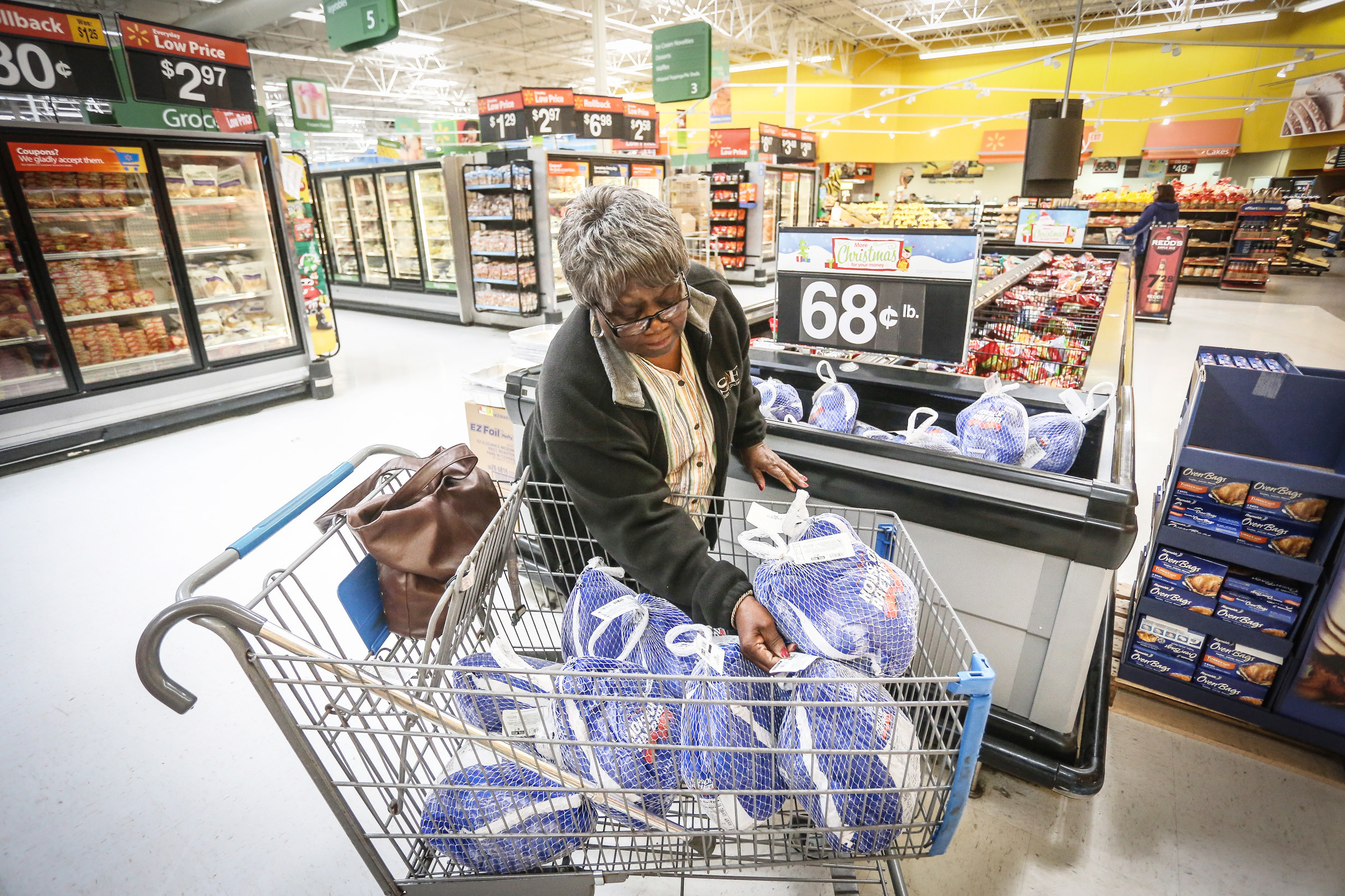 Geraldine Singleton shops for turkeys with donated money to feed the needy during a previous holiday season. Singleton is in her 33rd year of feeding the elderly and needy at Thanksgiving.