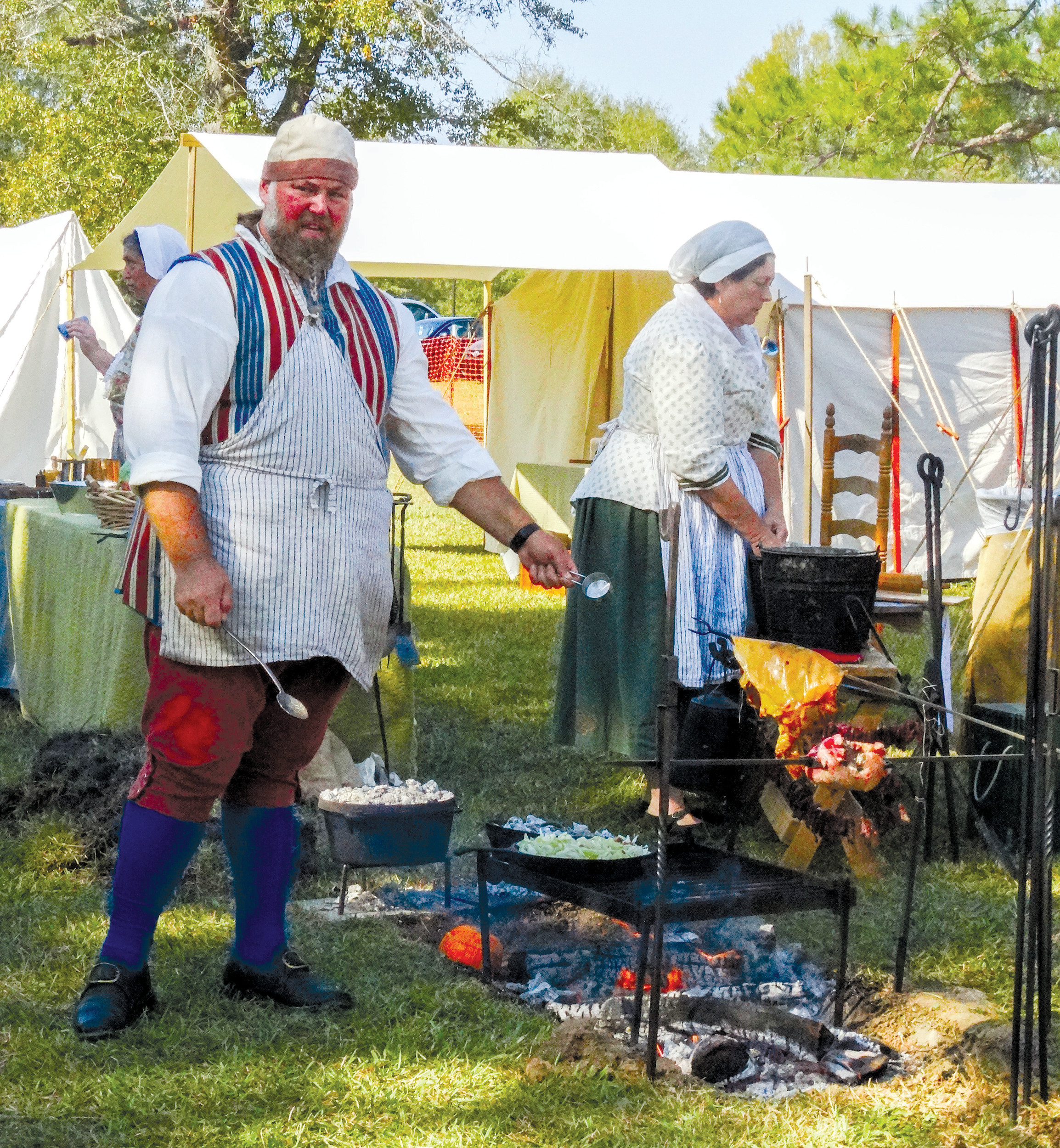 "Johnny Harris with American Colonial Civilian Interpreters cooks ""bubble and squeak,"" a dish that included cabbage."