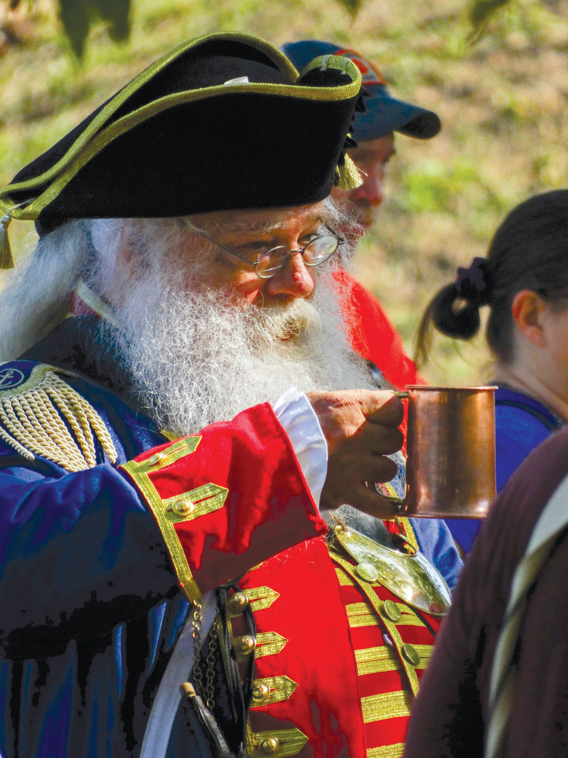 "Robert Woods, ""alias Santa Claus,"" he said, toasts a guest with his copper mug."