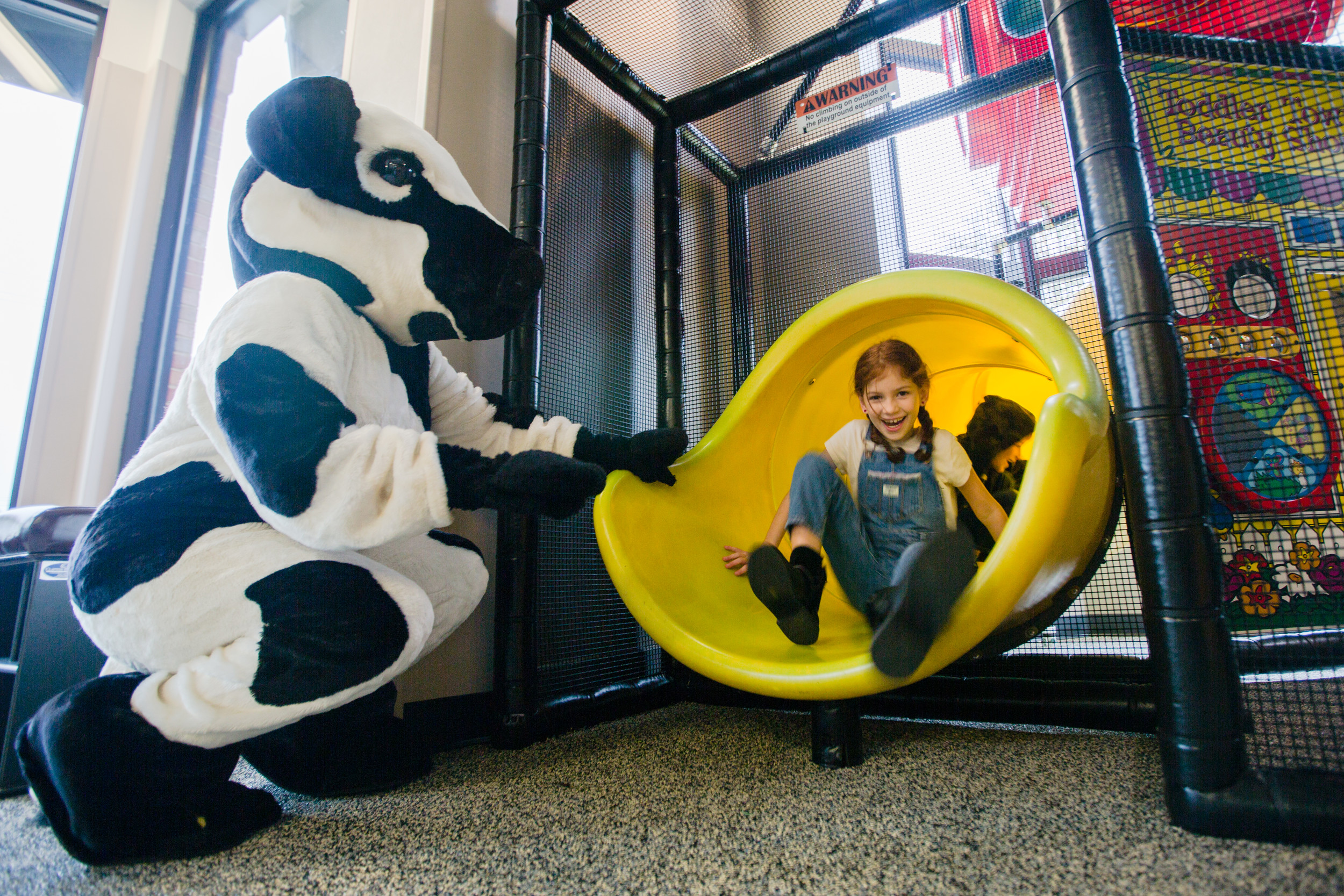 River Stewart comes down the slide in the play place at the newly re-opened Chickfila on Broad Street.