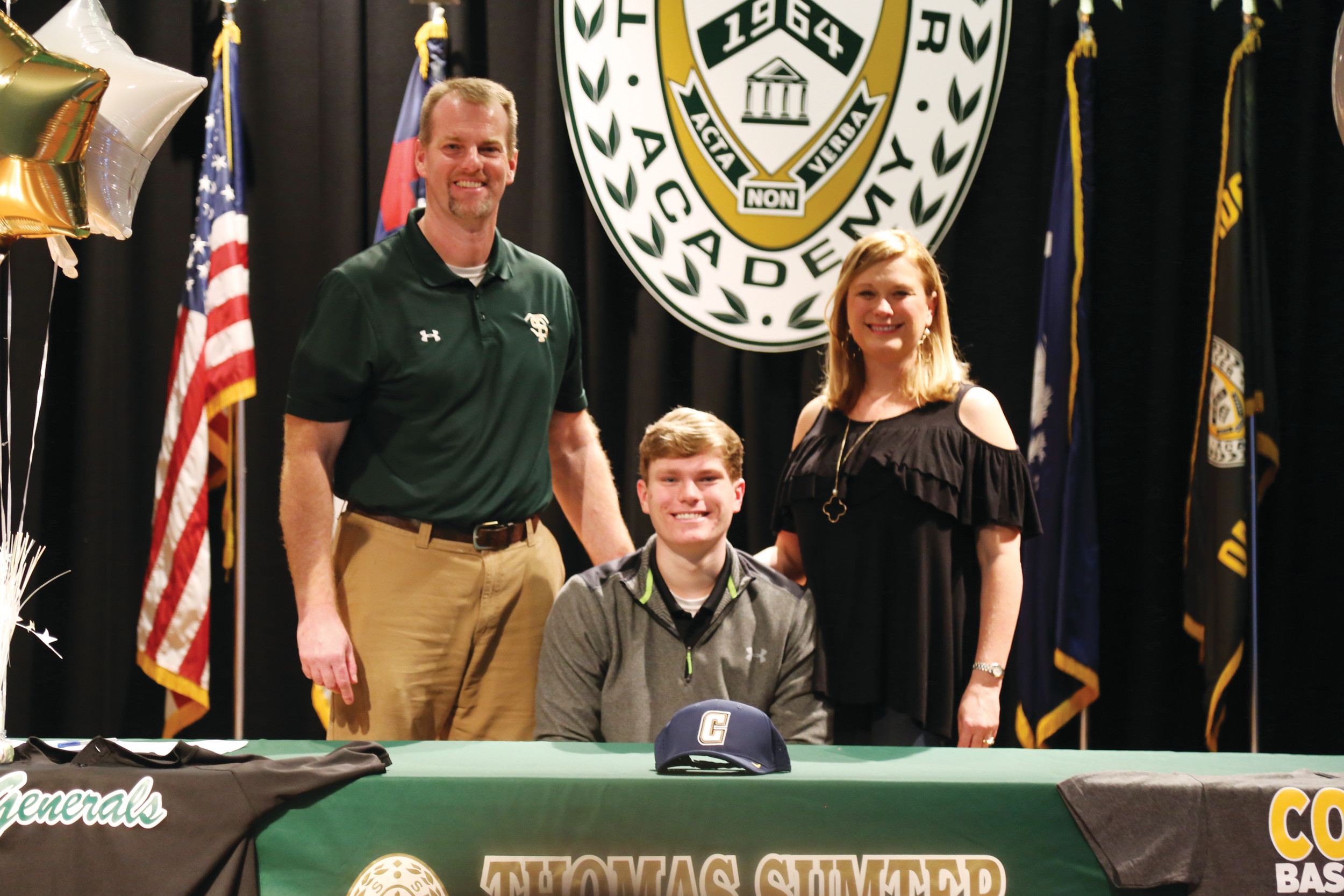 Thomas Sumter Academy's Josh Galloway, flanked by his parents, signs a letter of intent to play college baseball for Coker College.