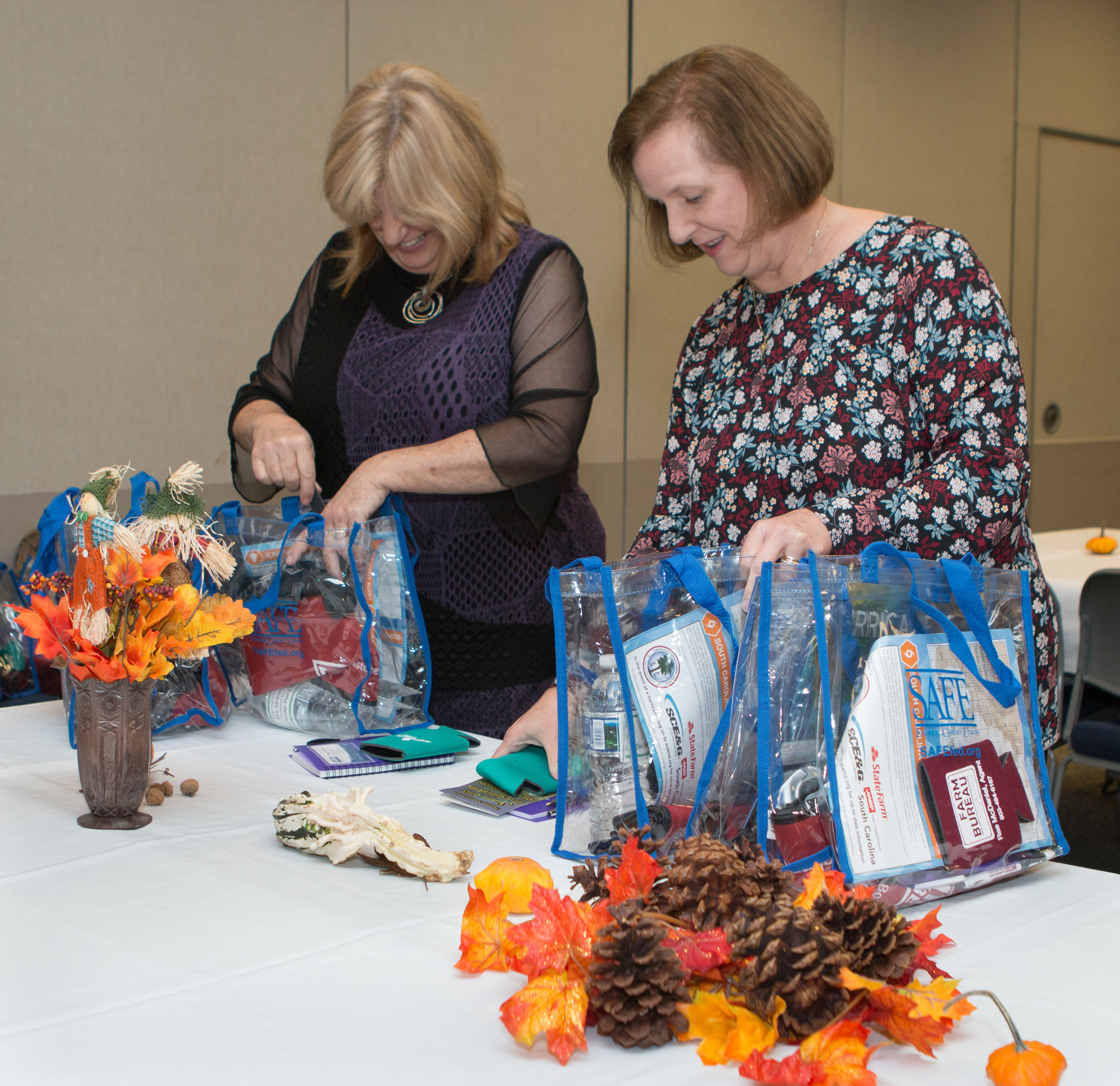 Sumter Pilot Club members Carolyn Bishop-McLeod, left, and Beth Justice fill gift bags for caregivers at the event.
