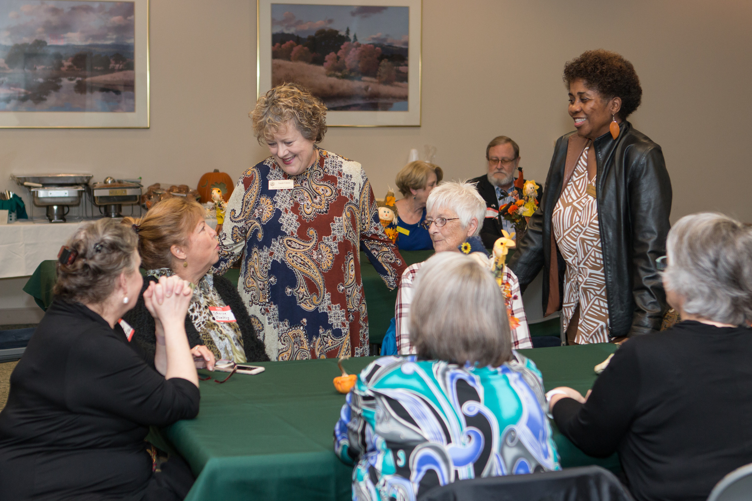 Sandi Edens, president of the Sumter Pilot Club, along with Noreen Wall, president-elect, greet caregivers during a luncheon held in their honor on Wednesday at Palmetto Health Tuomey. Palmetto Health Tuomey and the Pilot Club of Sumter hosted the third-annual Caregiver Luncheon to honor unpaid caregivers for their hard work and dedication in caring for their loved ones throughout the community.