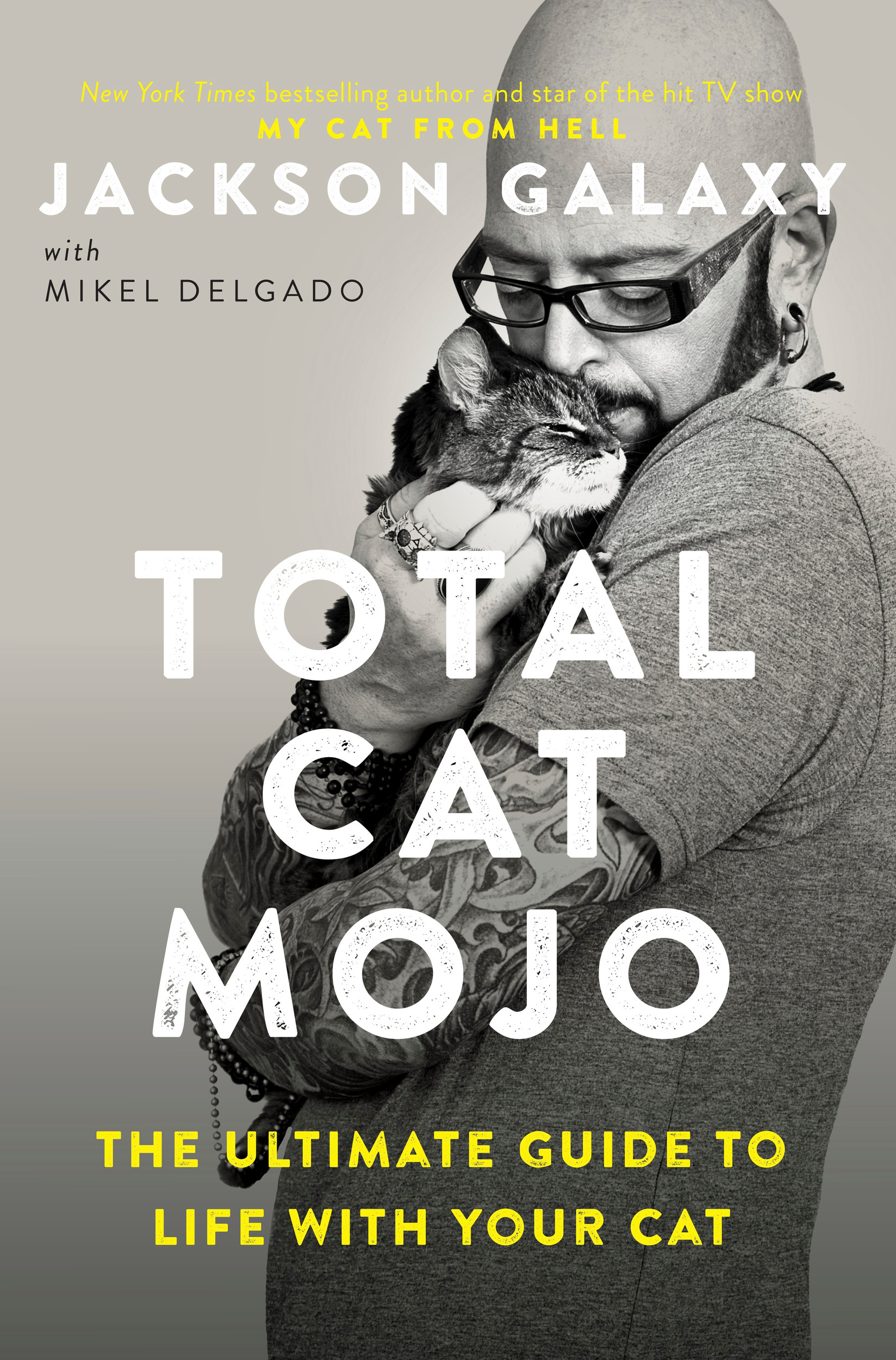 "This cover image released by Tarcher Perigee shows ""Total Cat Mojo: The Ultimate Guide to Life with Your Cat,"" a new book by Jackson Galaxy."