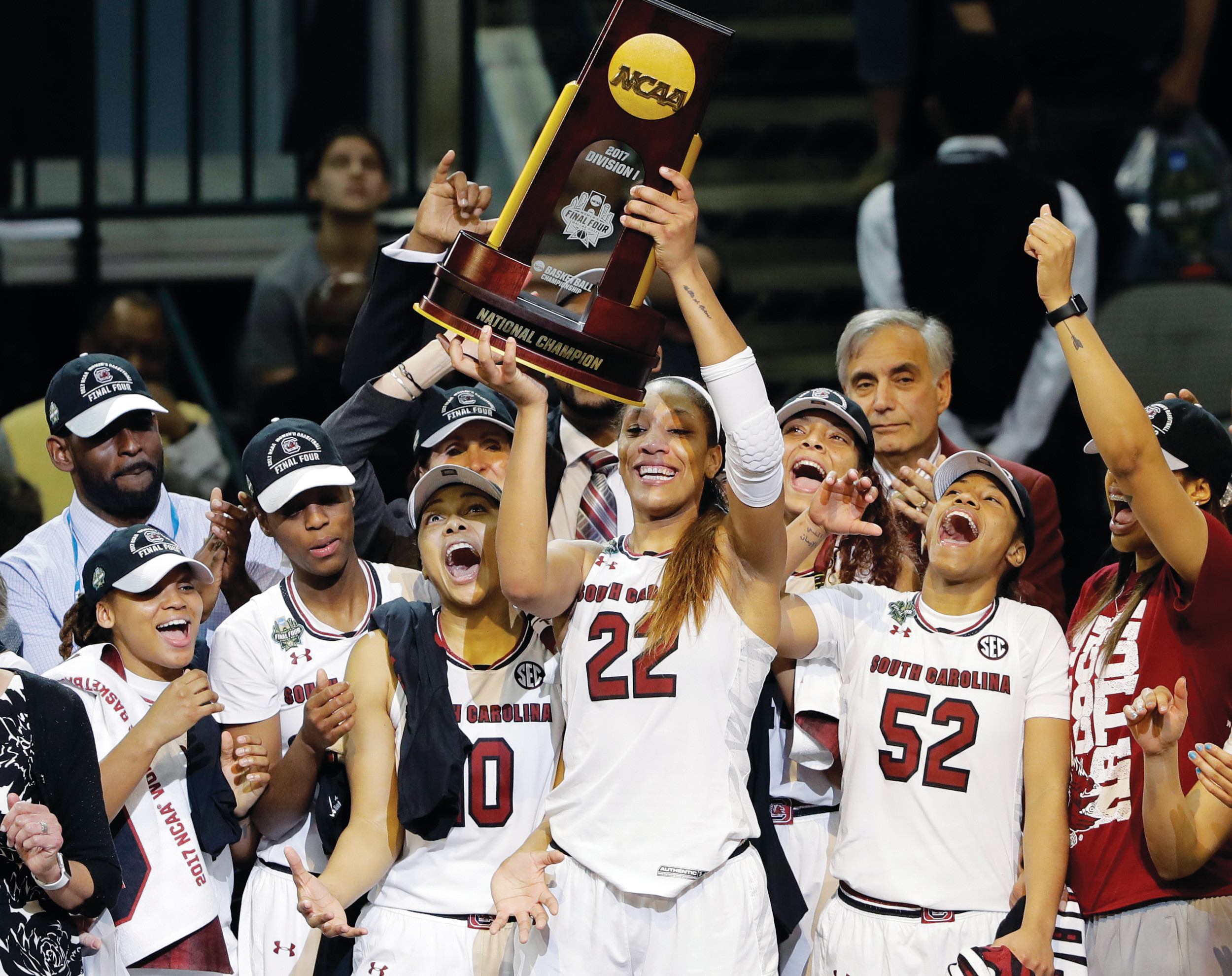 South Carolina forward A'ja Wilson (22) holds up the national championship trophy as she celebrates with teammates after their 67-55 win over Mississippi State in the final of last year's NCAA women's college basketball tournament in Dallas. Their title defense begins today at 6:30 p.m. at Colonial Life Arena in Columbia when they receive their championship rings and the banner is raised, followed by the season opener against Alabama State at 7.