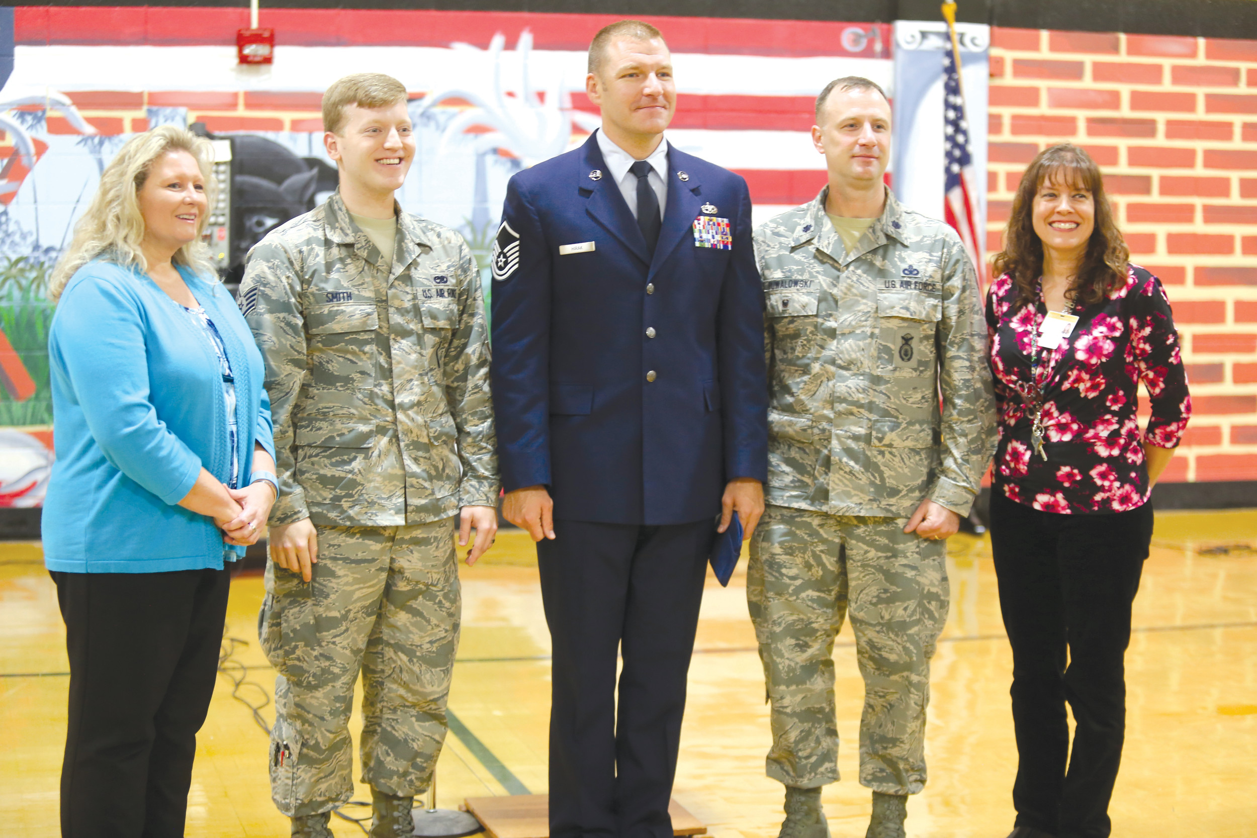 The three military speakers at Thursday's Veterans Day program at High Hills Elementary pose with school officials. From left is Principal Mary Kay Norton, Staff Sgt. Jimmy Smith, Master Sgt. Christopher Hirak, Lt. Col. Nathan Puwalowski and school Instructional Coach Anja Comerford.