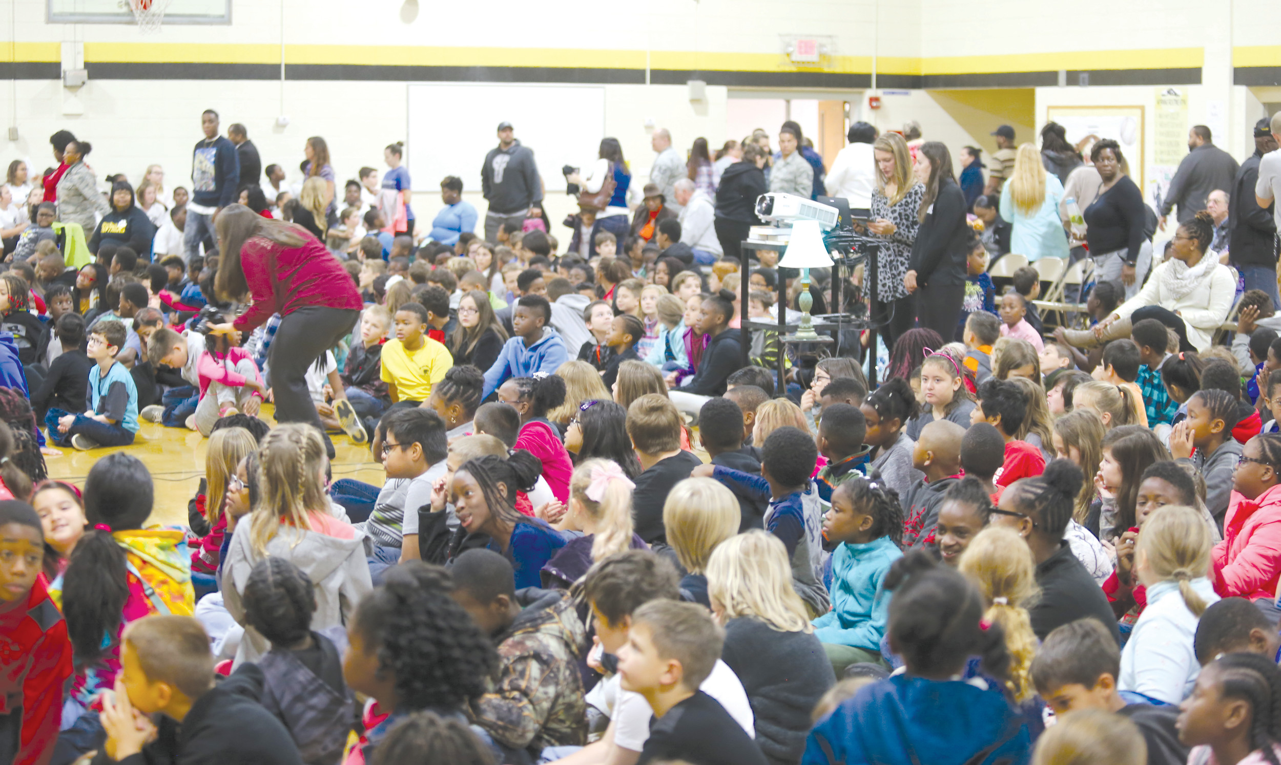 High Hills Elementary School students sit and listen Thursday during the school's Veterans Day program.