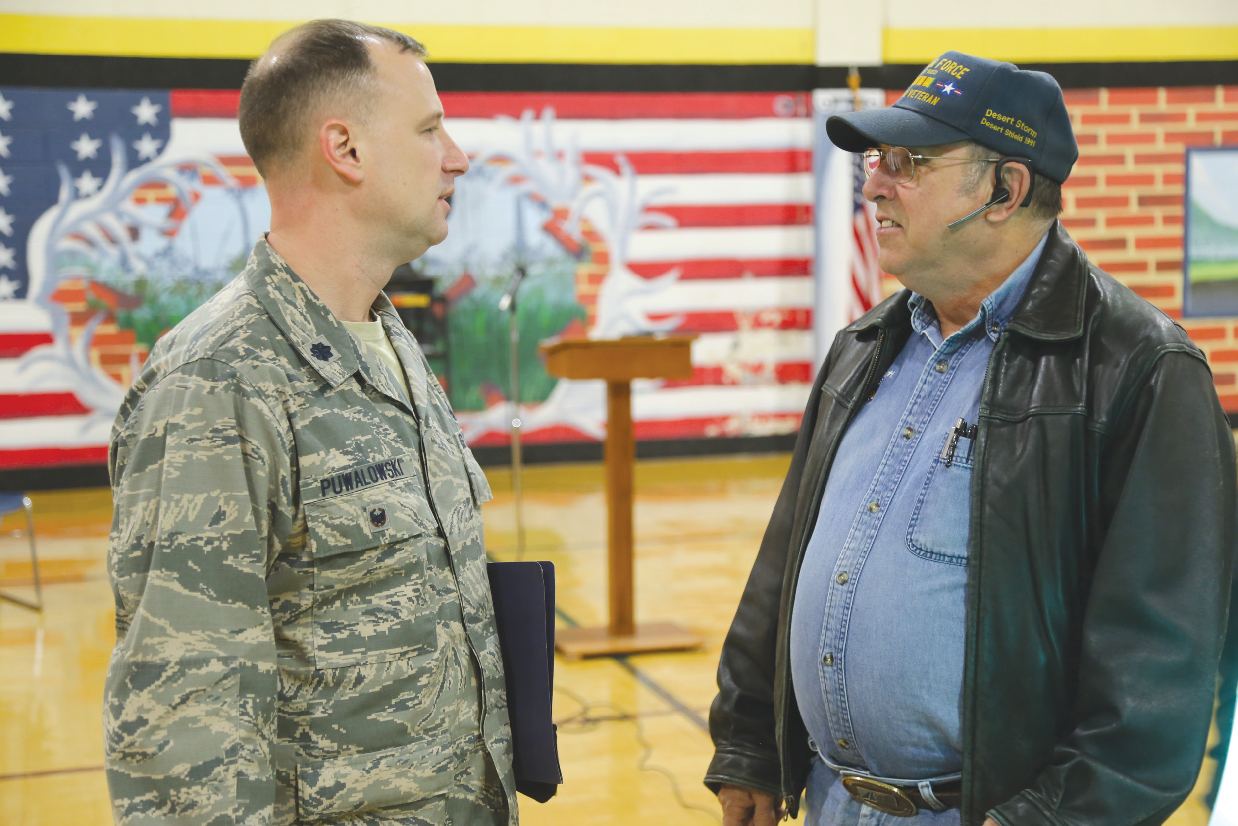 Shaw airman Lt. Col. Nathan Puwalowski, left, speaks with Air Force veteran and Sumter resident Chuck Conley on Thursday at High Hills Elementary. Puwalowski was the keynote speaker for the school's Veterans Day program. Both men have children that attend the school.