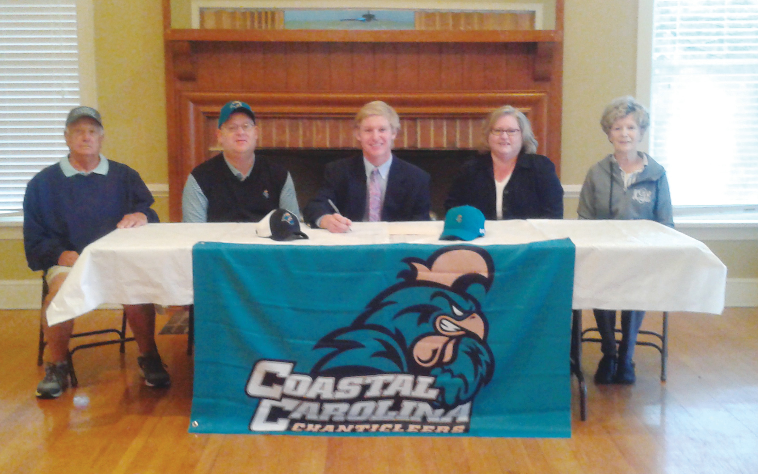 Thomas Sumter Academy's Tyler Gray signs a letter of intent to play golf at Coastal Carolina University.