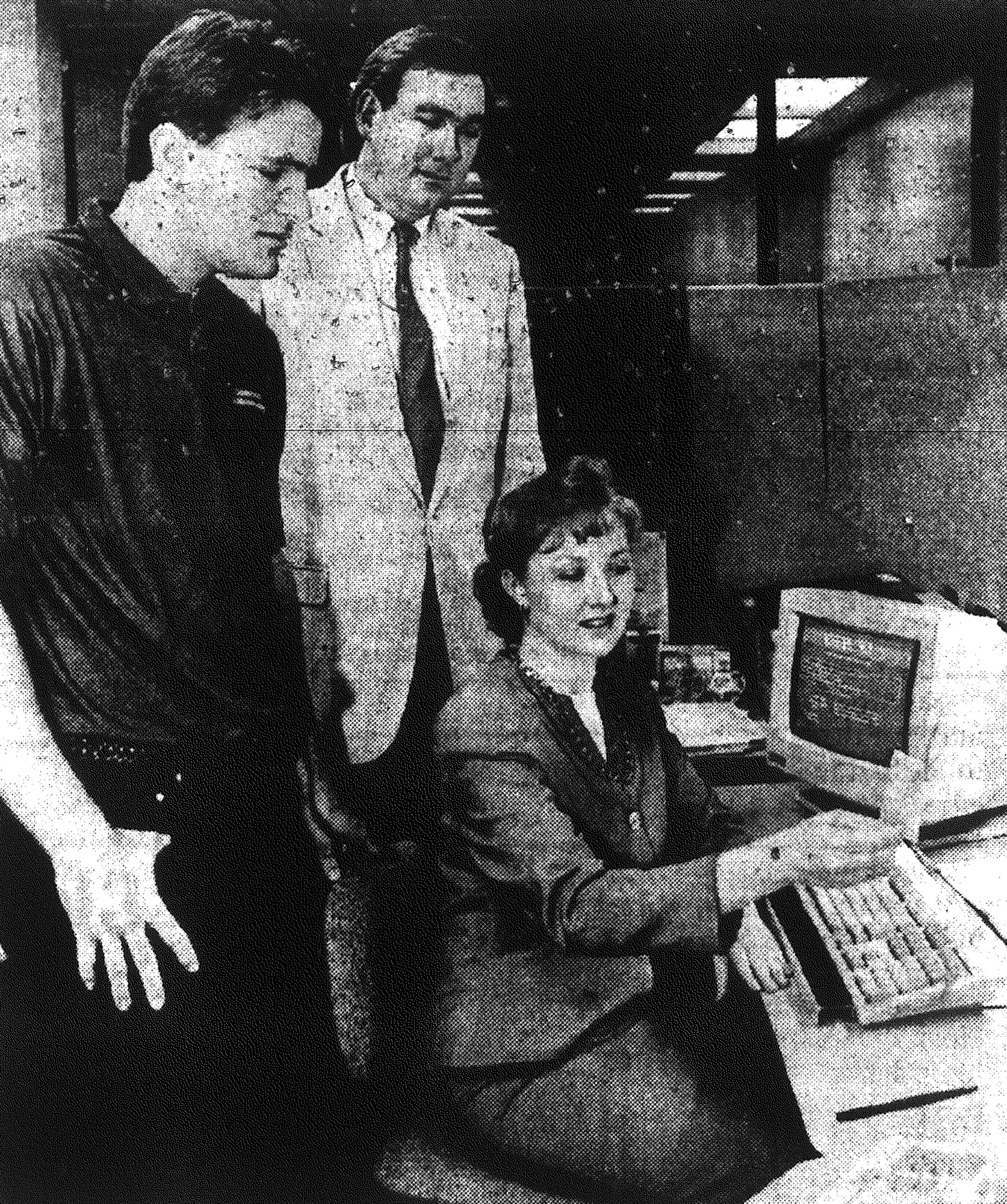 1992 - University of South Carolina Sumter student Hayne Painter, left, and Dale Bullard, assistant dean of student affairs, watch as Kathryn Bullard prepares a student development transcript for Painter.