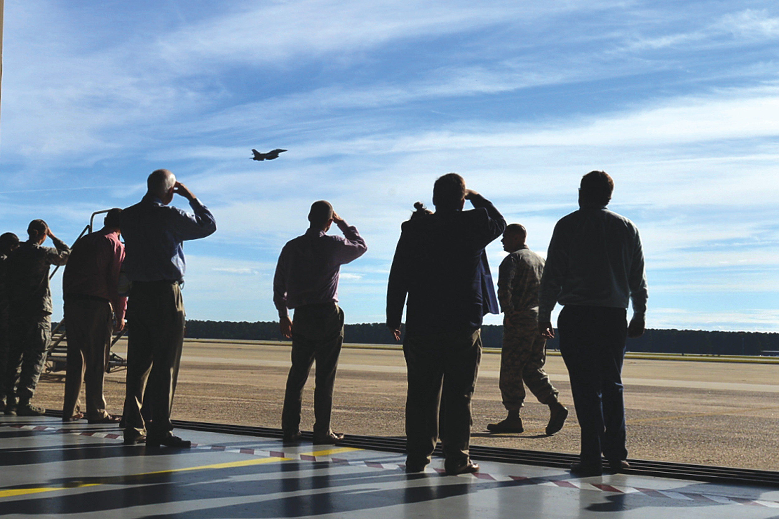 Members of the Shaw-Sumter Community Council watch an F-16CM Fighting Falcon depart Shaw Air Force Base on Nov. 2. During the tour of the installation, SSCC visited an engine test facility, the control tower and the weapon standardization hangar.