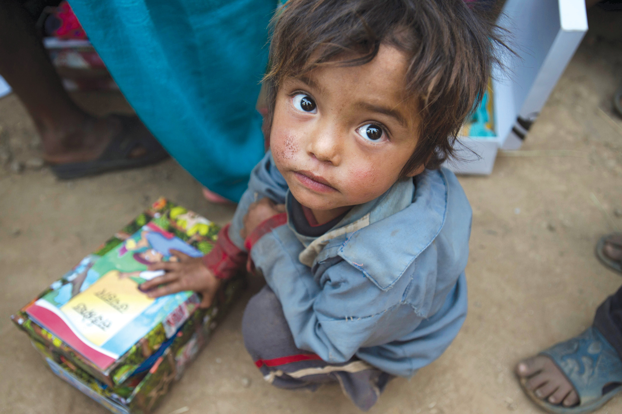 A child in Nepal receives a shoebox gift as part of Operation Christmas Child.