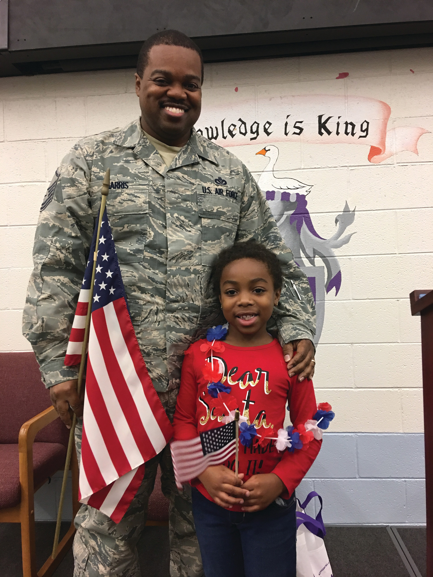 Kingsbury Elementary School student Nevaih Harris is seen with her dad, Master Sgt. Thomas Harris, who was the guest speaker at the school's Veterans Day program. Harris recently returned home from 