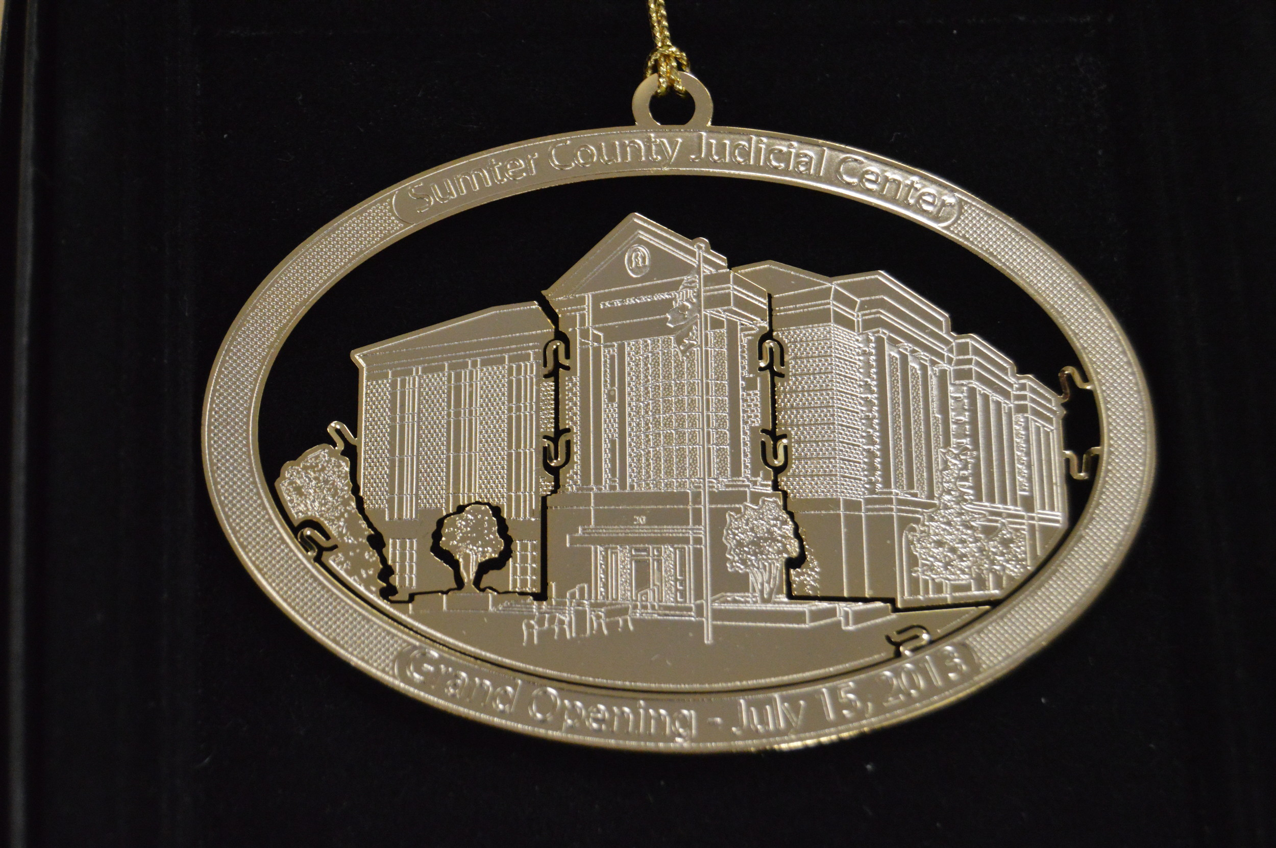 Sumter Volunteers' 2017 Keepsakes Series ornament celebrates the construction of Sumter County Judicial Center, a 2008 Capital Penny Sales Tax project, which opened its doors in 2013.