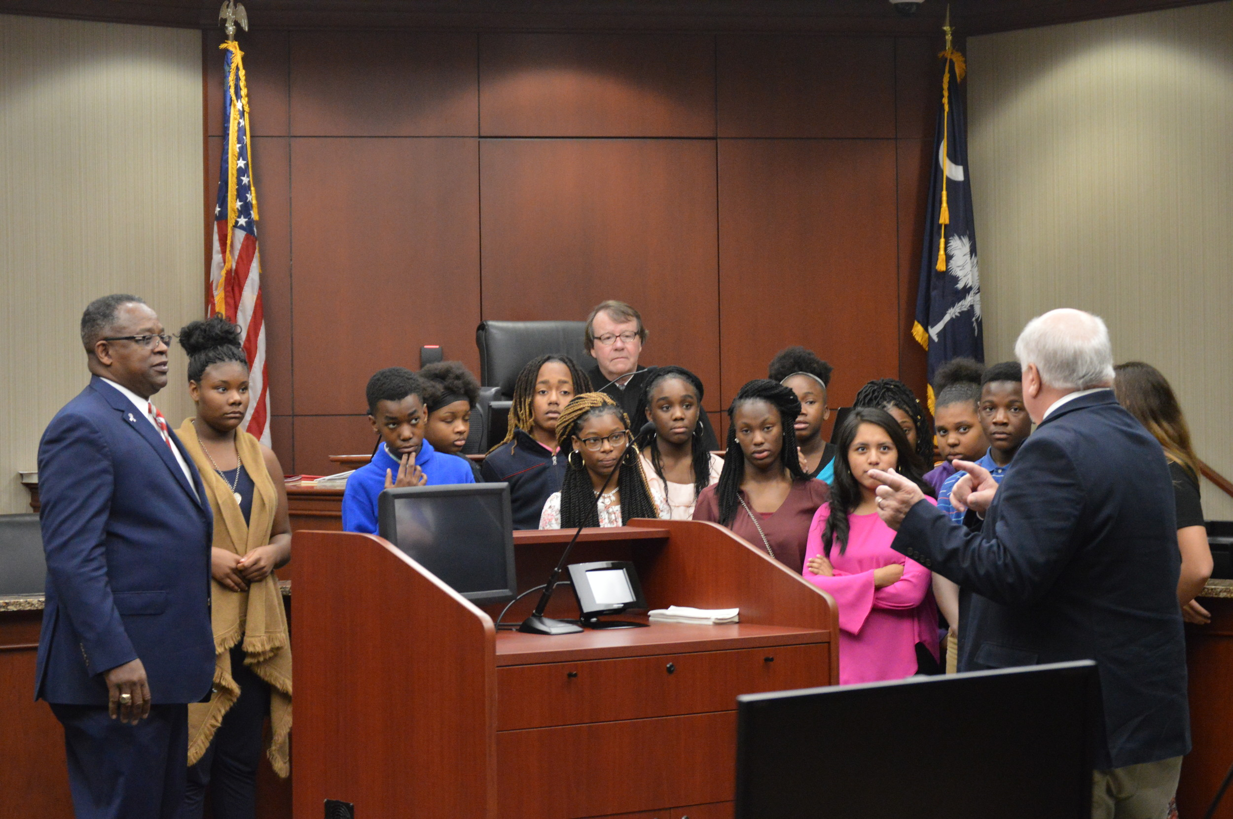 Sumter County Family Court Assistant Solicitor speaks with Alice Drive Middle School students after the teens sat through four trials involving people their own age on Thursday.