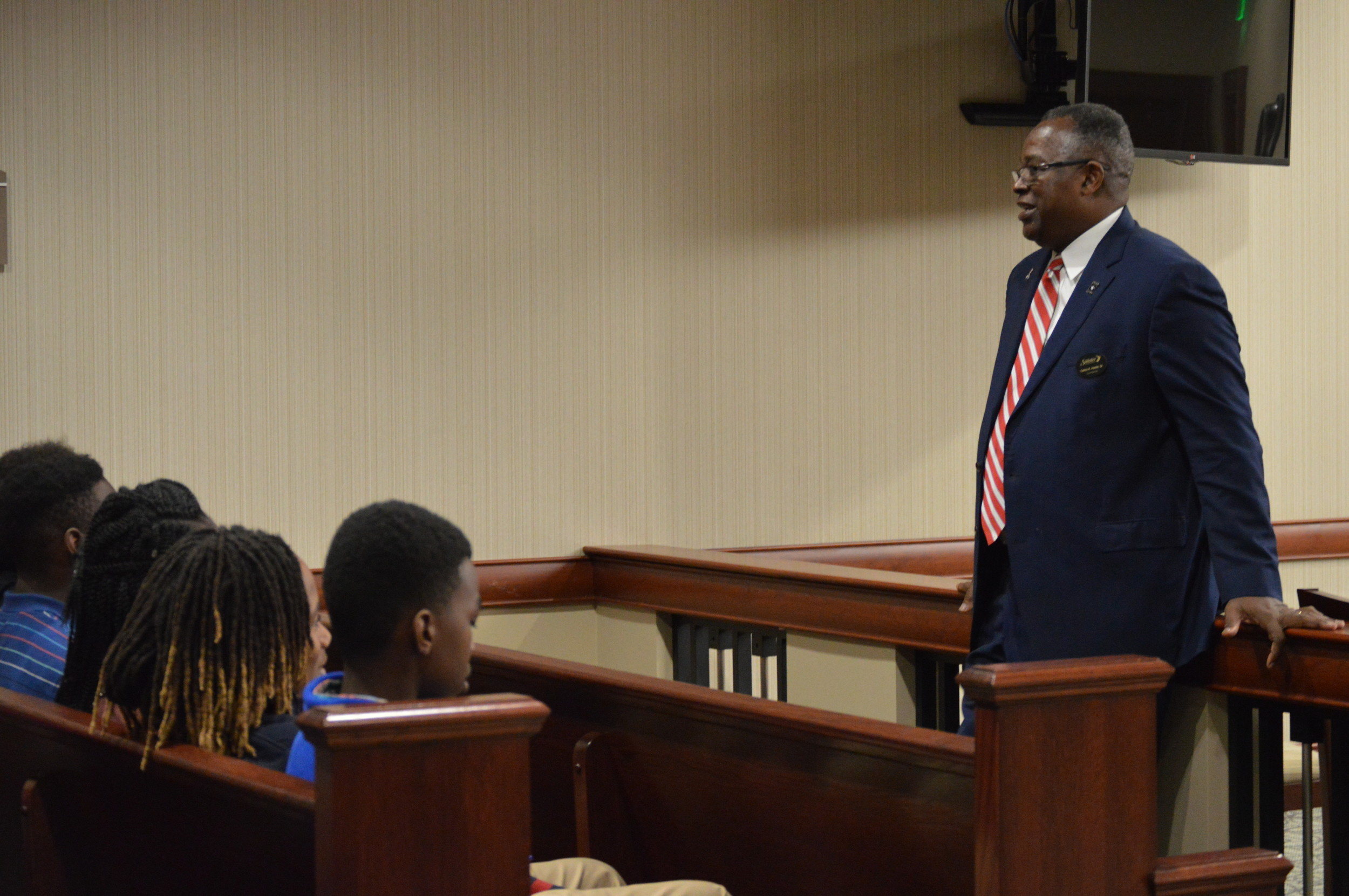 Public defender Calvin Hastie speaks with a class of seventh- and eighth-grade students from Alice Drive Middle School before a trail regarding a juvenile at Sumter County Judicial Center on Thursday.