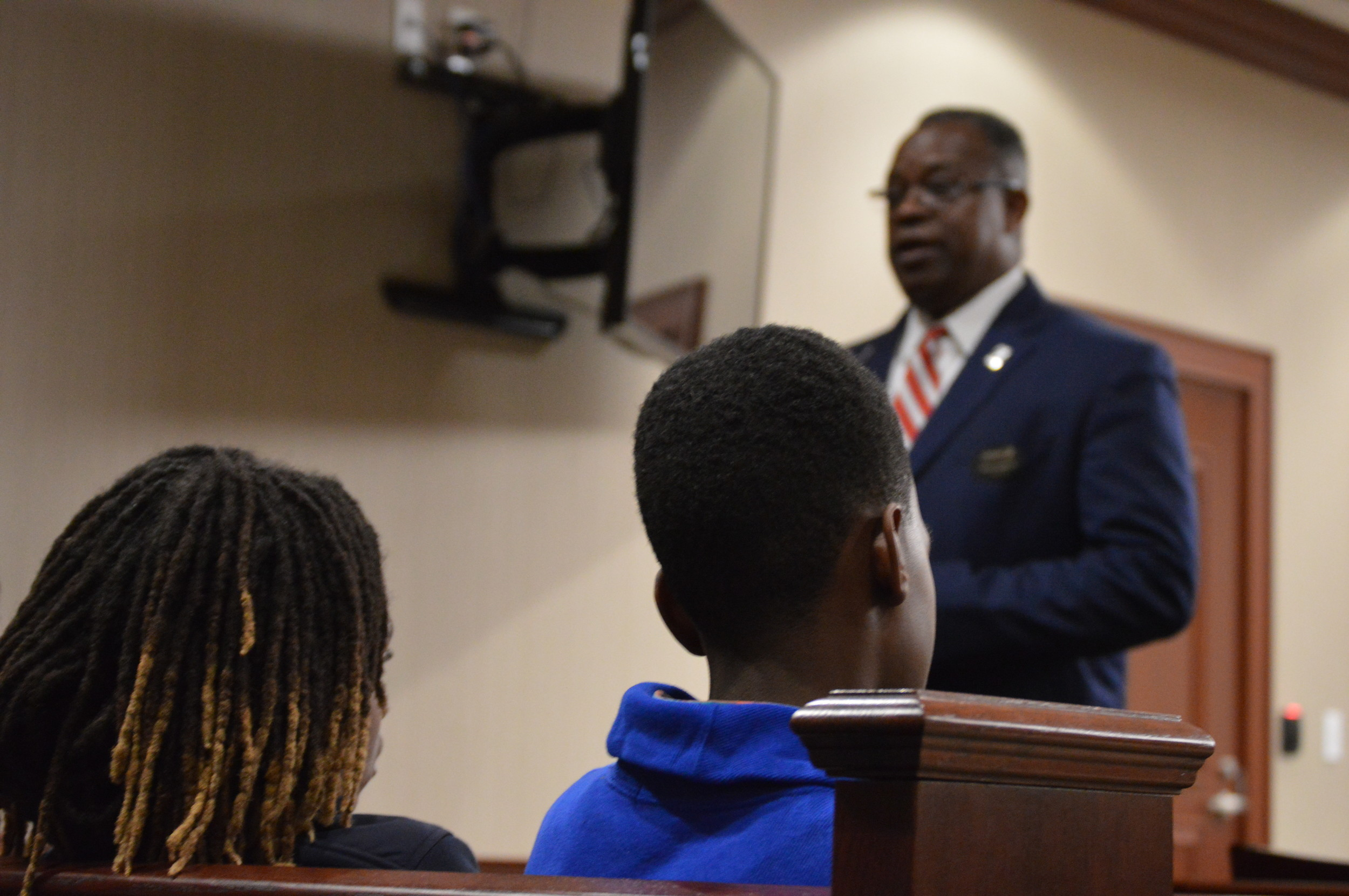 Public defender Calvin Hastie speaks with students from Alice Drive Middle School before a trail involving a juvenile at Sumter County Judicial Center on Thursday.