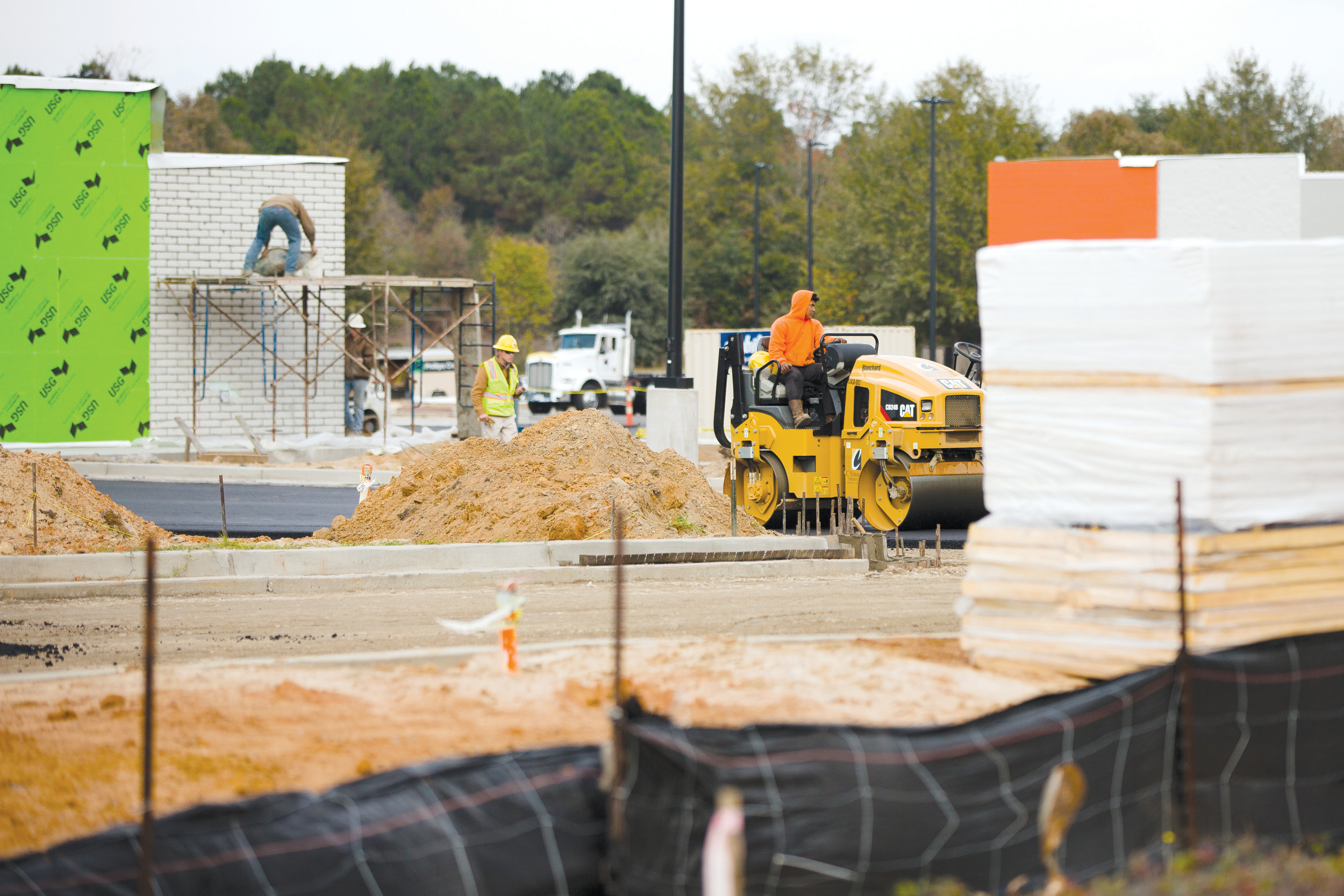 A construction crew works on the new Walmart Neighborhood Market on Pinewood Road on Tuesday afternoon. The store is hiring 125 people for jobs ranging from clerks to pharmacy positions and has a hiring center at 19 Pinewood Road, Suite No. 3.