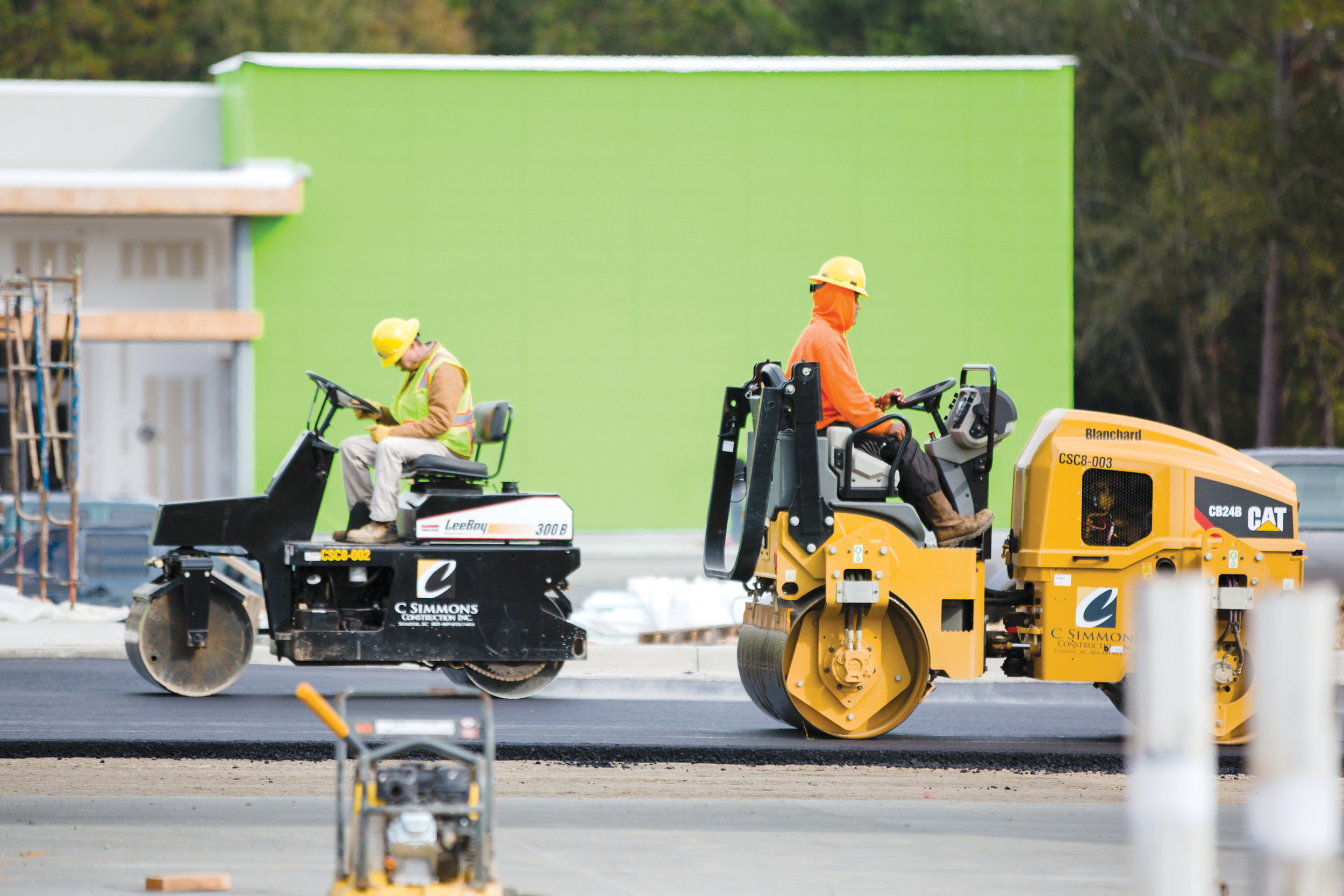 A crew paves a lot at the new Walmart Neighborhood Market on Pinewood Road on Tuesday.
