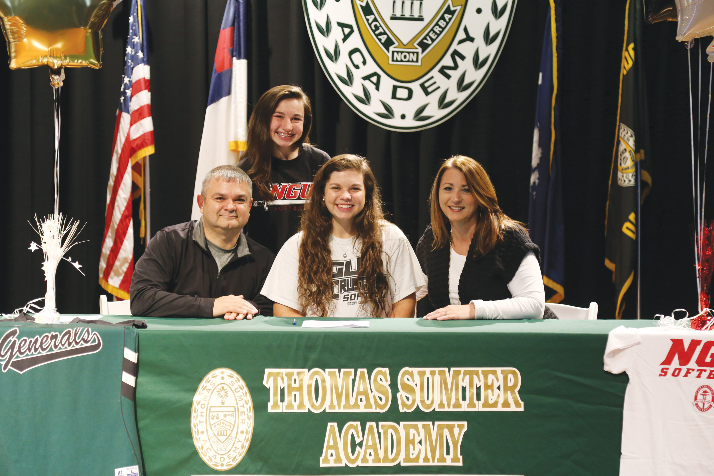 Thomas Sumter's Carmen Silvester is flanked by her parents and sister as she signs a letter of intent to play softball at North Greenville University in Tigerville last week.