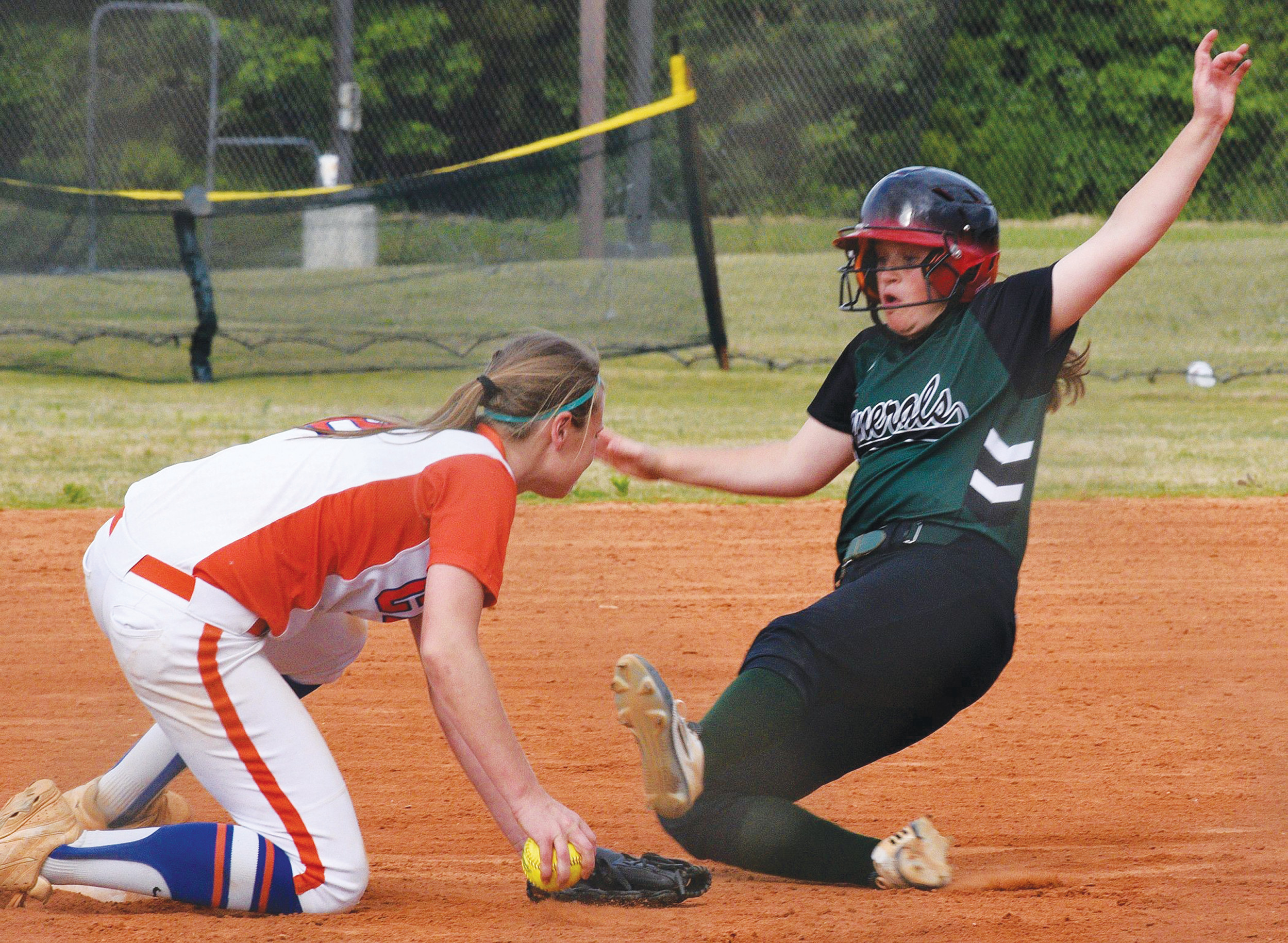 Thomas Sumter Academy's Josie Reed, shown sliding into second base, signed to play college softball with
