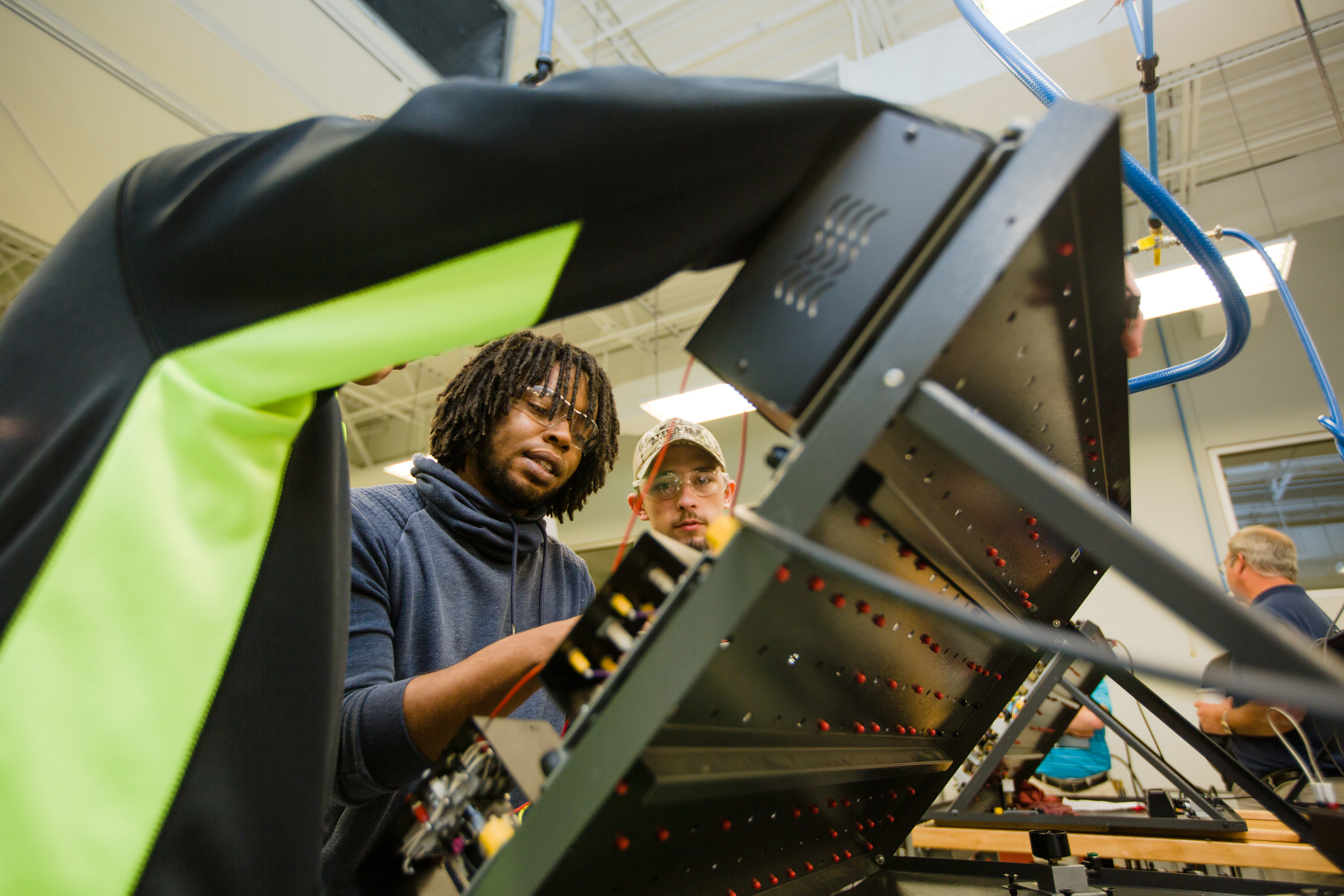 Jayson Price, Martin Jackson and Morgan Jones work on circuit boards at Central Carolina Technical College on Tuesday.