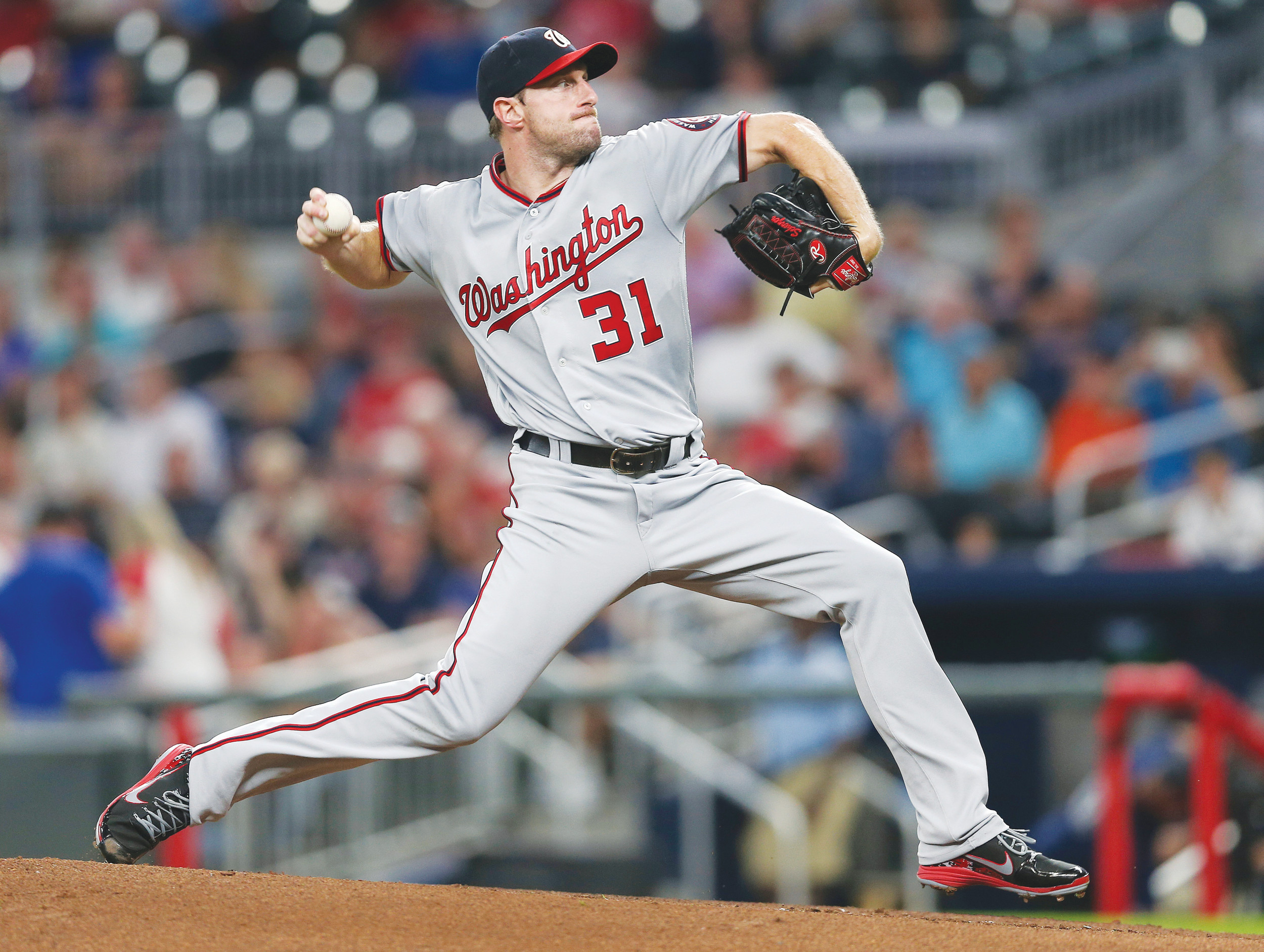 Washington pitcher Max Scherzer won his third Cy Young Award, winning for the second straight year in the National League.