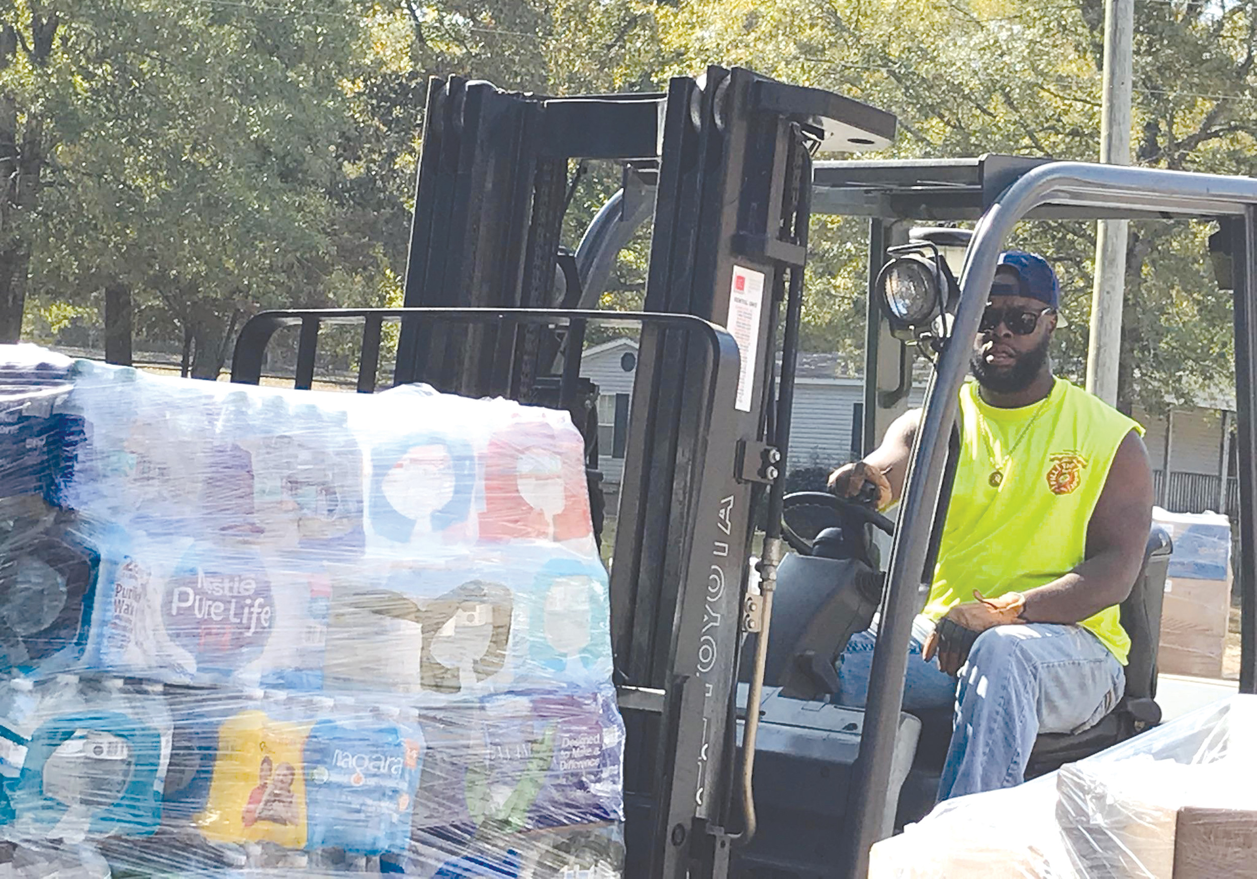 Julian Harris of Grant Hill Missionary Baptist Church in Rembert loads a pallet of water onto a truck recently as part of a relief effort for victims of Hurricane Harvey in Beaumont, Texas.