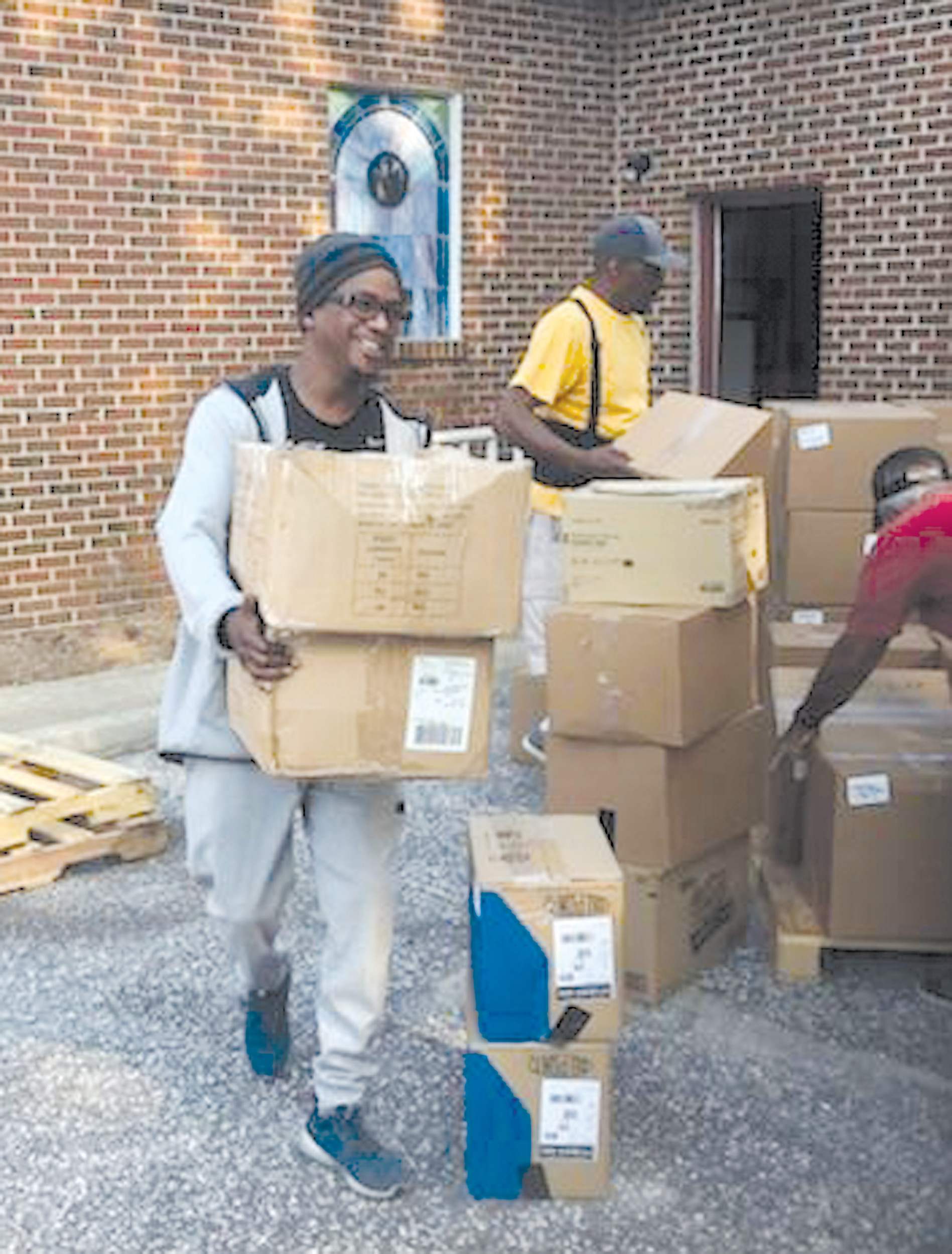 The Rev. Clifton Witherspoon, pastor of Grant Hill Missionary Baptist Church in Rembert, carries boxes of supplies recently during the church's relief effort for victims of of Hurricane Harvey.