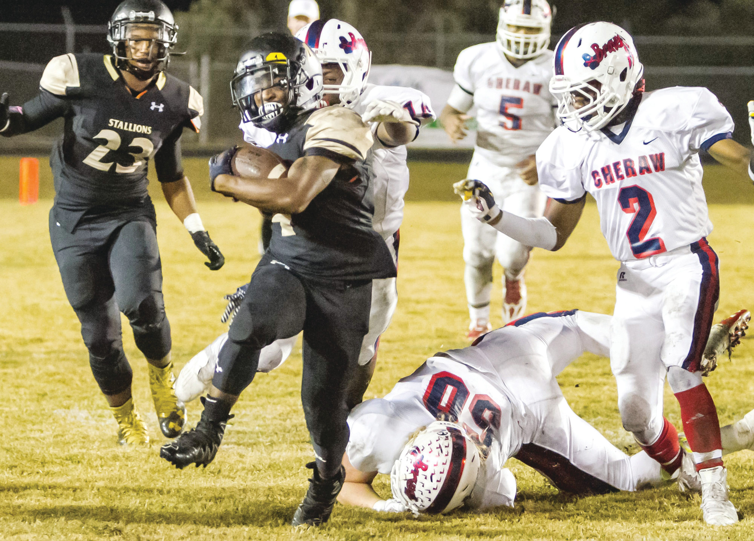 Lee Central  running back  Demetrius  Dubose (4)  slips away  from a would-be  tackler during  the Stallions'  regular-season  game against  Cheraw. Lee  Central travels  to face Saluda  today in the  quarterfinals of the 2A state playoffs.