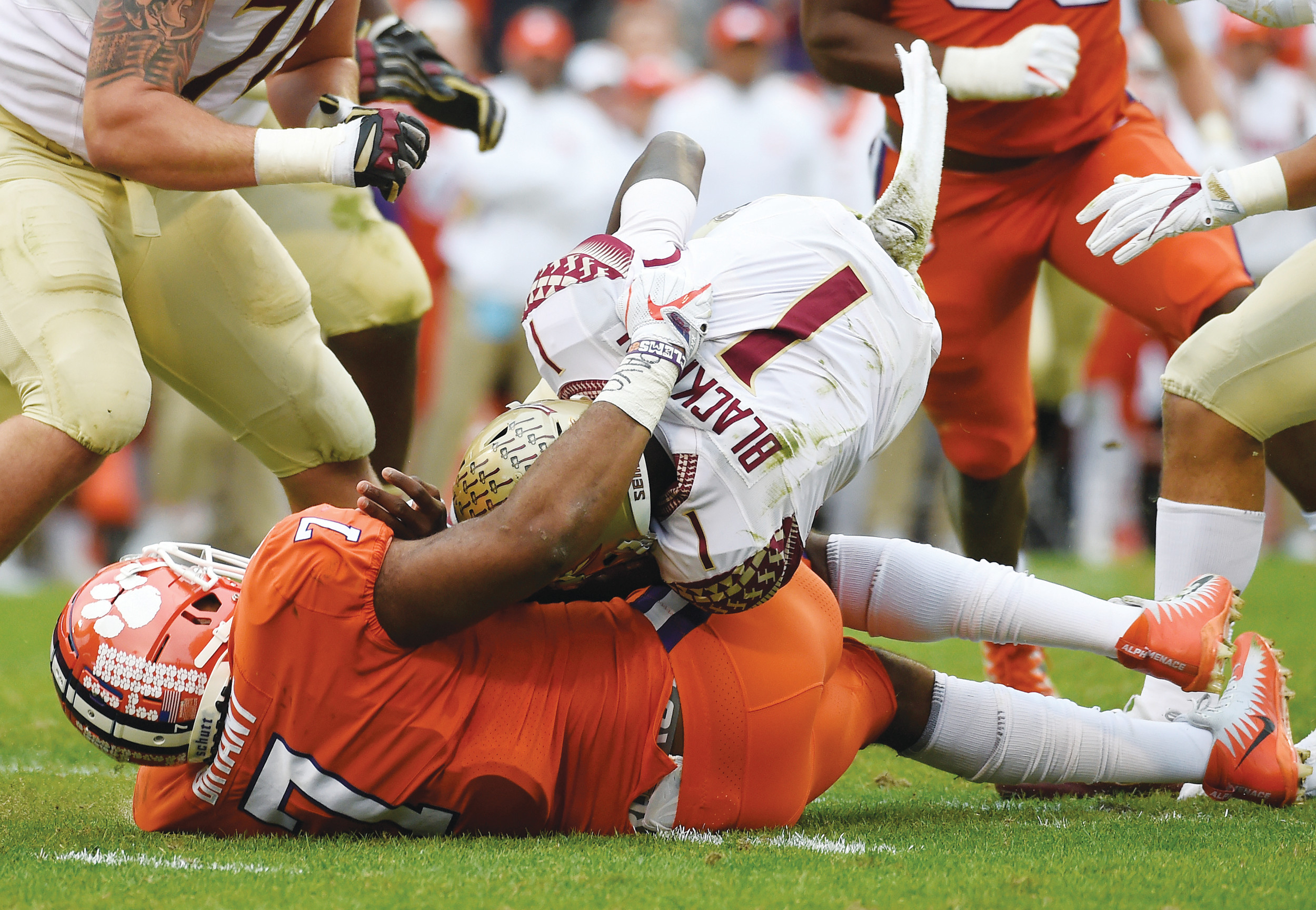 Clemson defensive end Austin Bryant (7) sacks Florida State quarterback James Blackman (1) during the first half of the Tigers' 31-14 victory on Saturday in Clemson. The Tigers will play host to The Citadel this Saturday at noon.