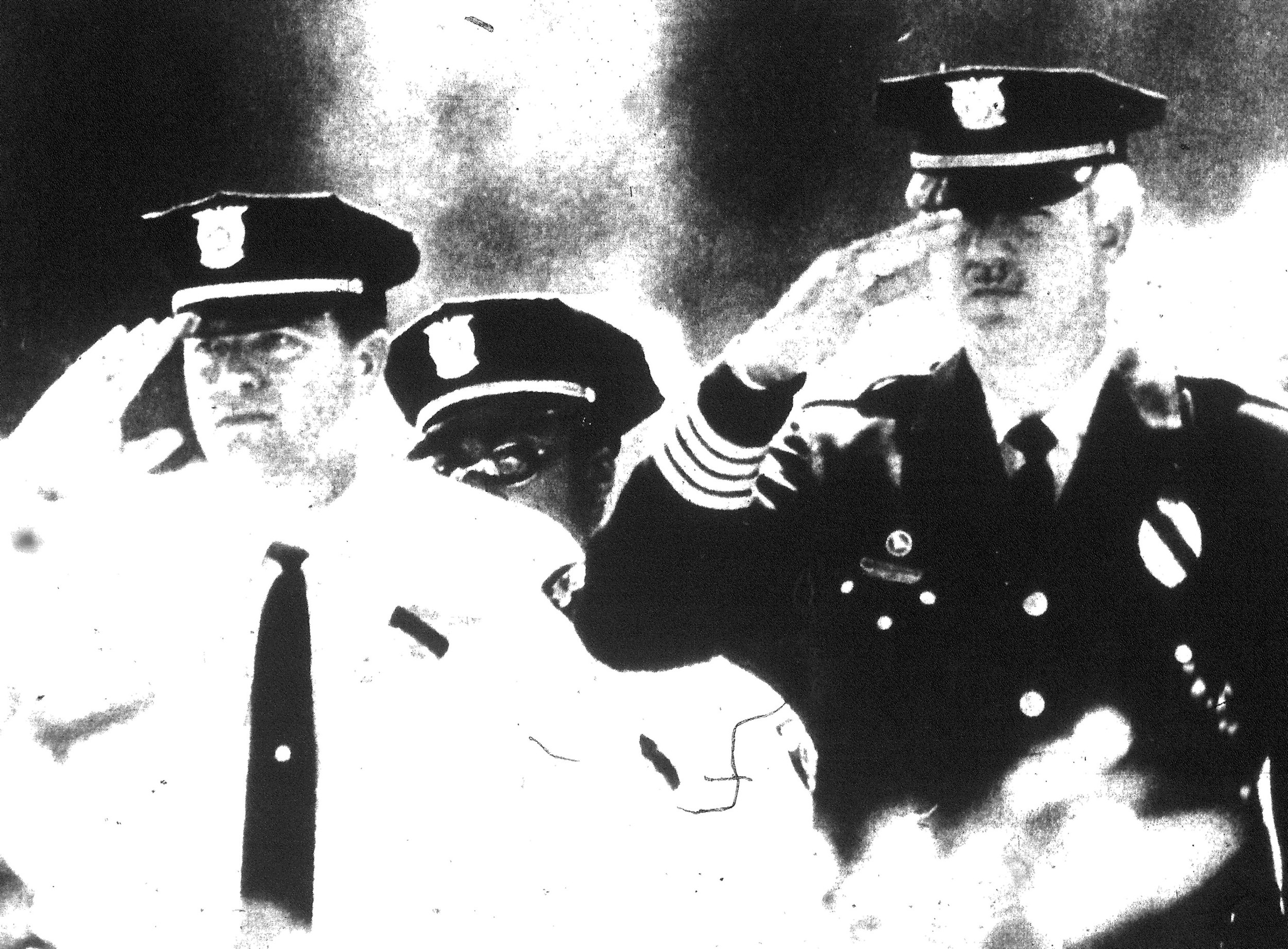 This photo appeared on the March 1, 1996, front page of The Item. Sumter Police Chief Harold Johnson, right, and fellow officers salute slain Sumter County Sheriff's Office Deputy Sgt. Charlie Kubala at his funeral.