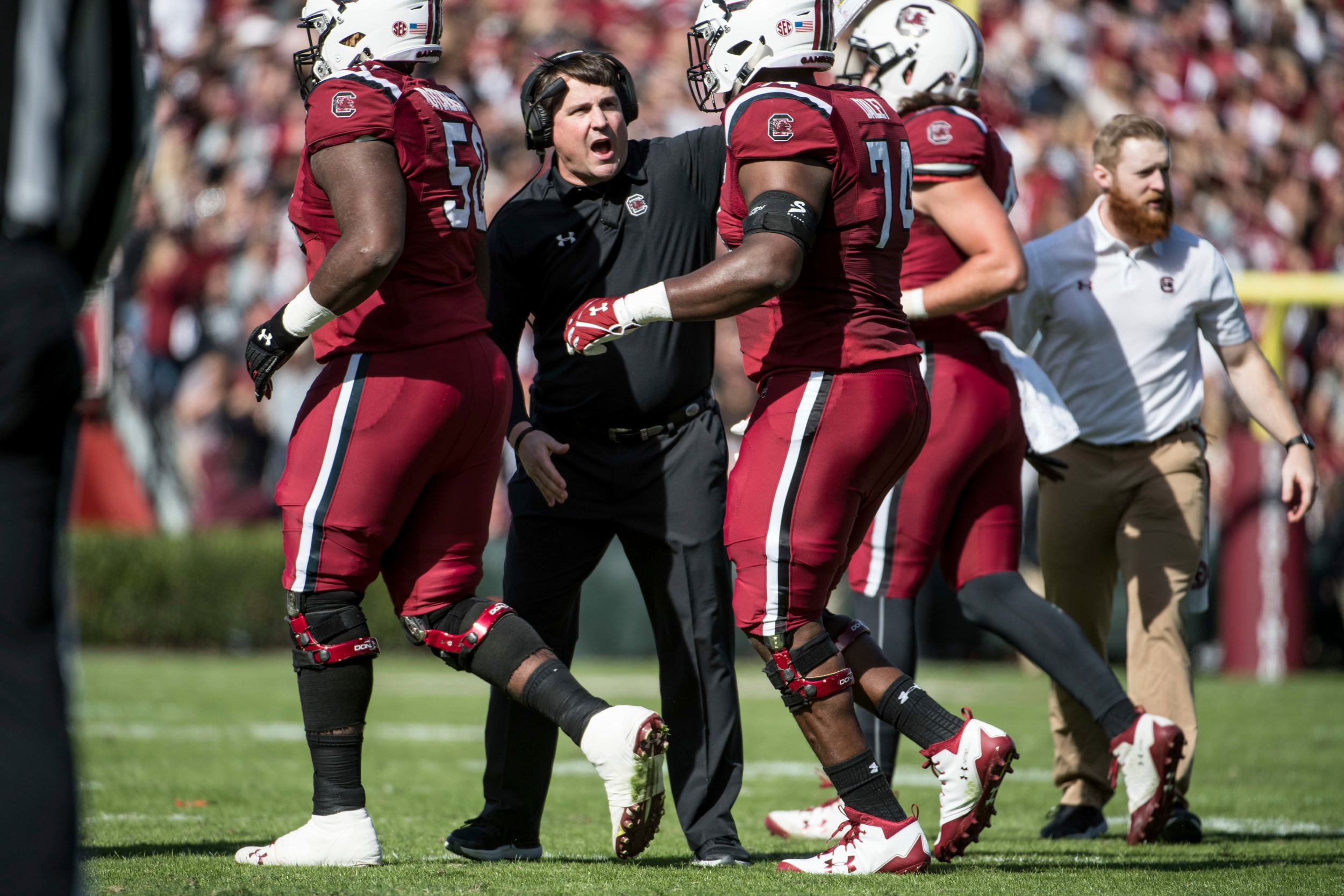 South Carolina football head coach Will Muschamp talks to his players during the Gamecocks' 28-20 victory over Florida last week. USC plays host to Wofford today.