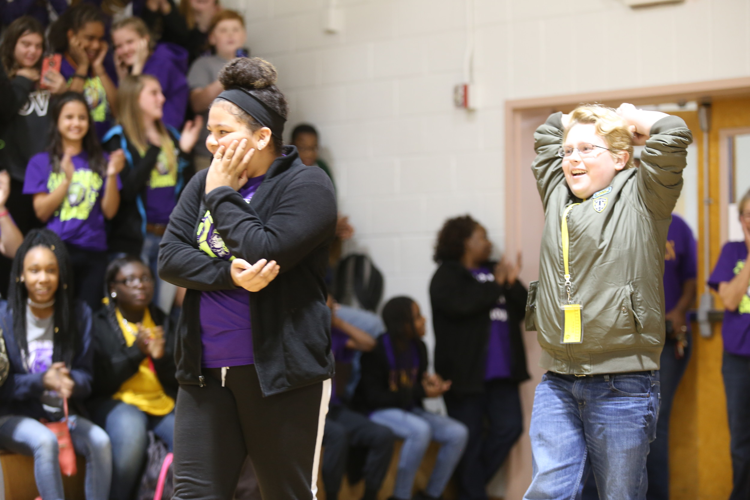 BRUCE MILLS / THE SUMTER ITEM Furman Middle School seventh-graders Taylor Gooden, left, and Quinn Welsh look stunned Friday as they enter the school's gym for a surprise sendoff celebration. The two are auditioning today in Savannah, Georgia, for America's Got Talent.
