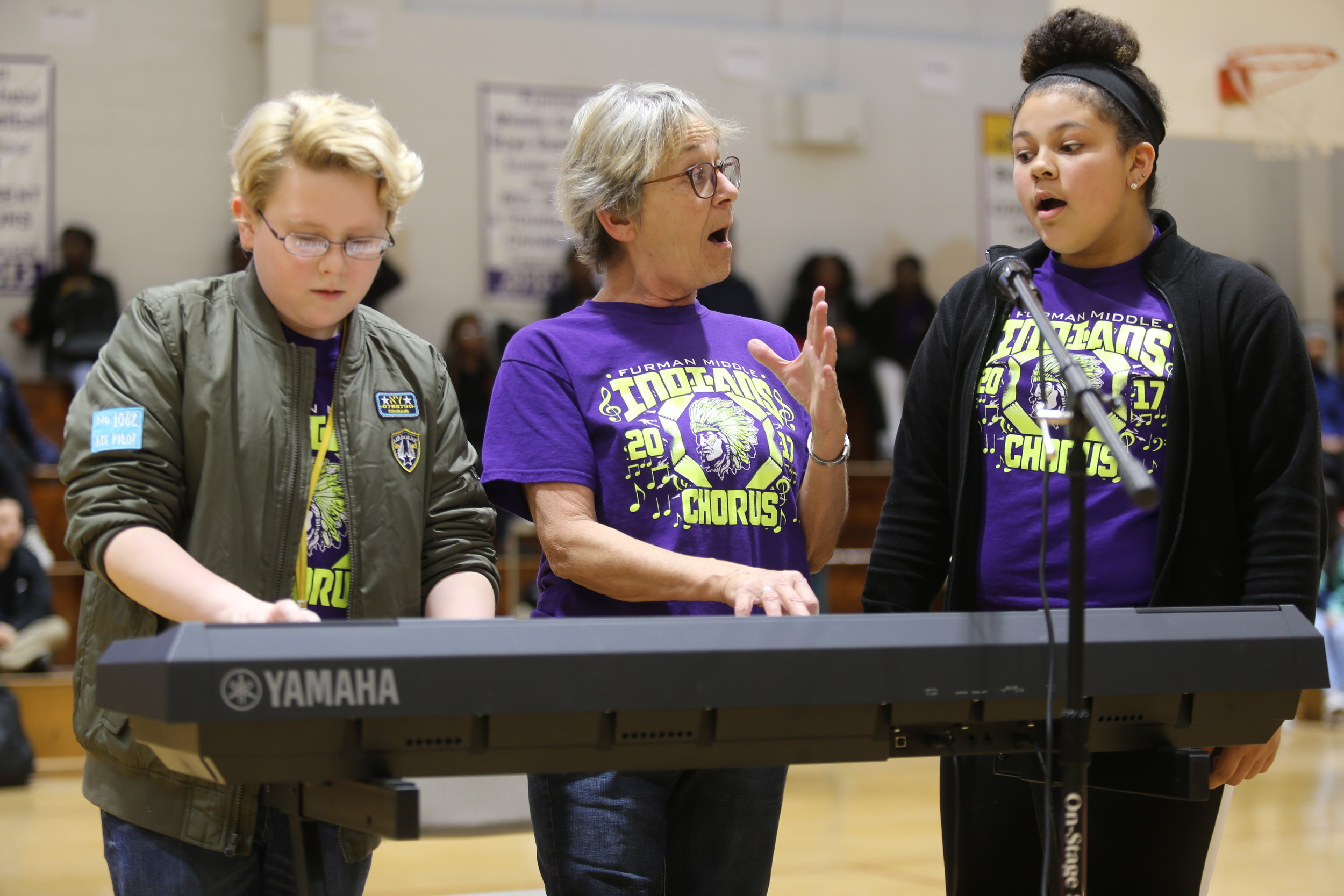 BRUCE MILLS / THE SUMTER ITEM From left, Welsh performs on the keyboard Friday as Furman Choral Director Linda Beck sings with Gooden in the school's gym.
