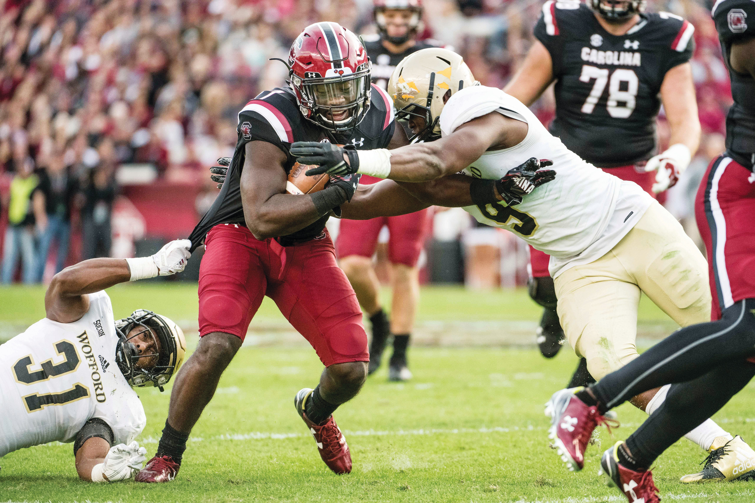 South Carolina running back Ty'Son Williams (27) carries the ball against Wofford safety Malik Rivera (31) and Terrance Morris (9) during the Gamecocks' 31-10 victory on Saturday in Columbia.