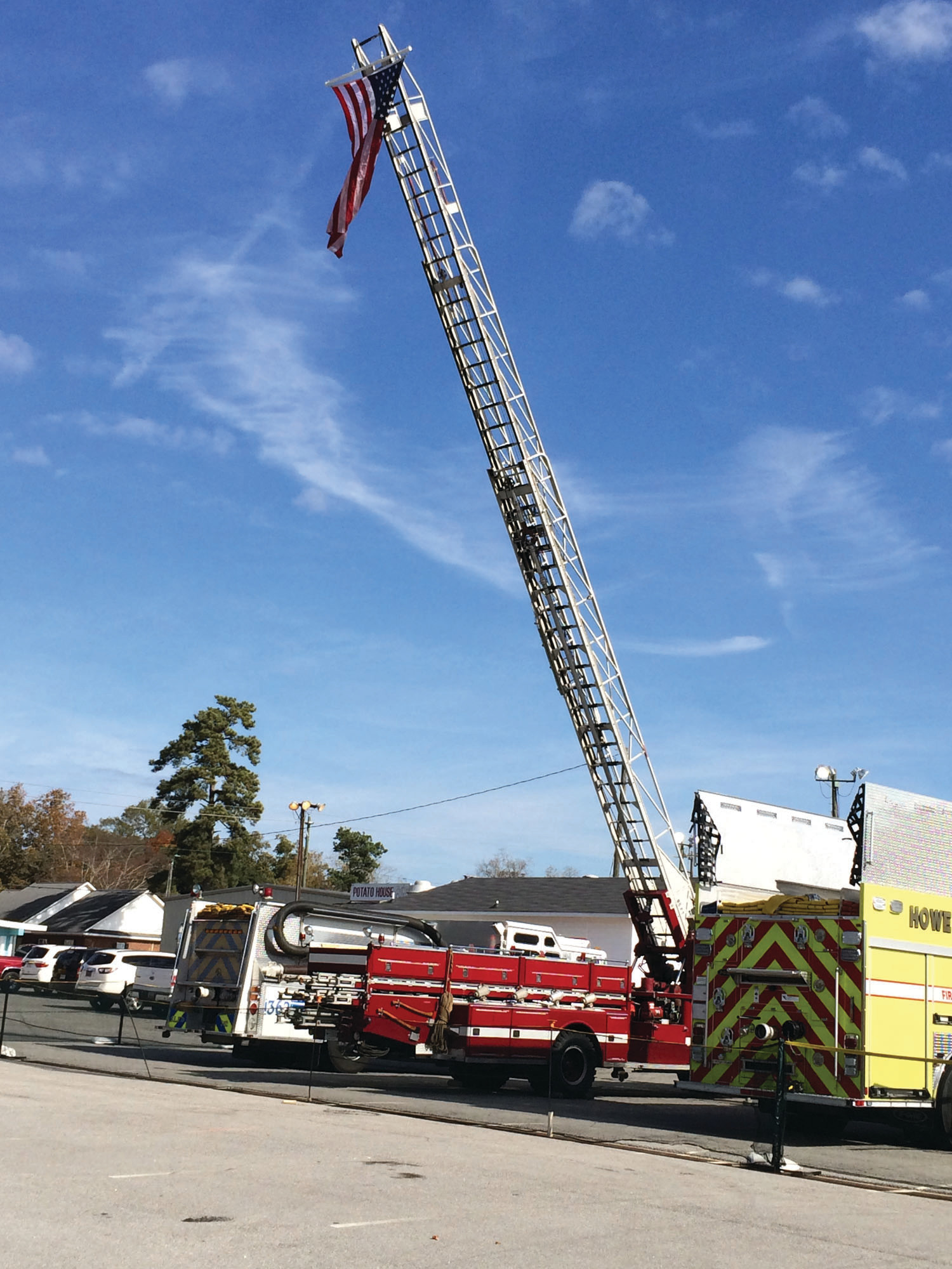 South Lynches Fire Department flew its large U.S. flag over the Sumter fairgrounds during the Eighth-Annual Capt. Tom Garrity Firefighters' BBQ Challenge on Saturday.