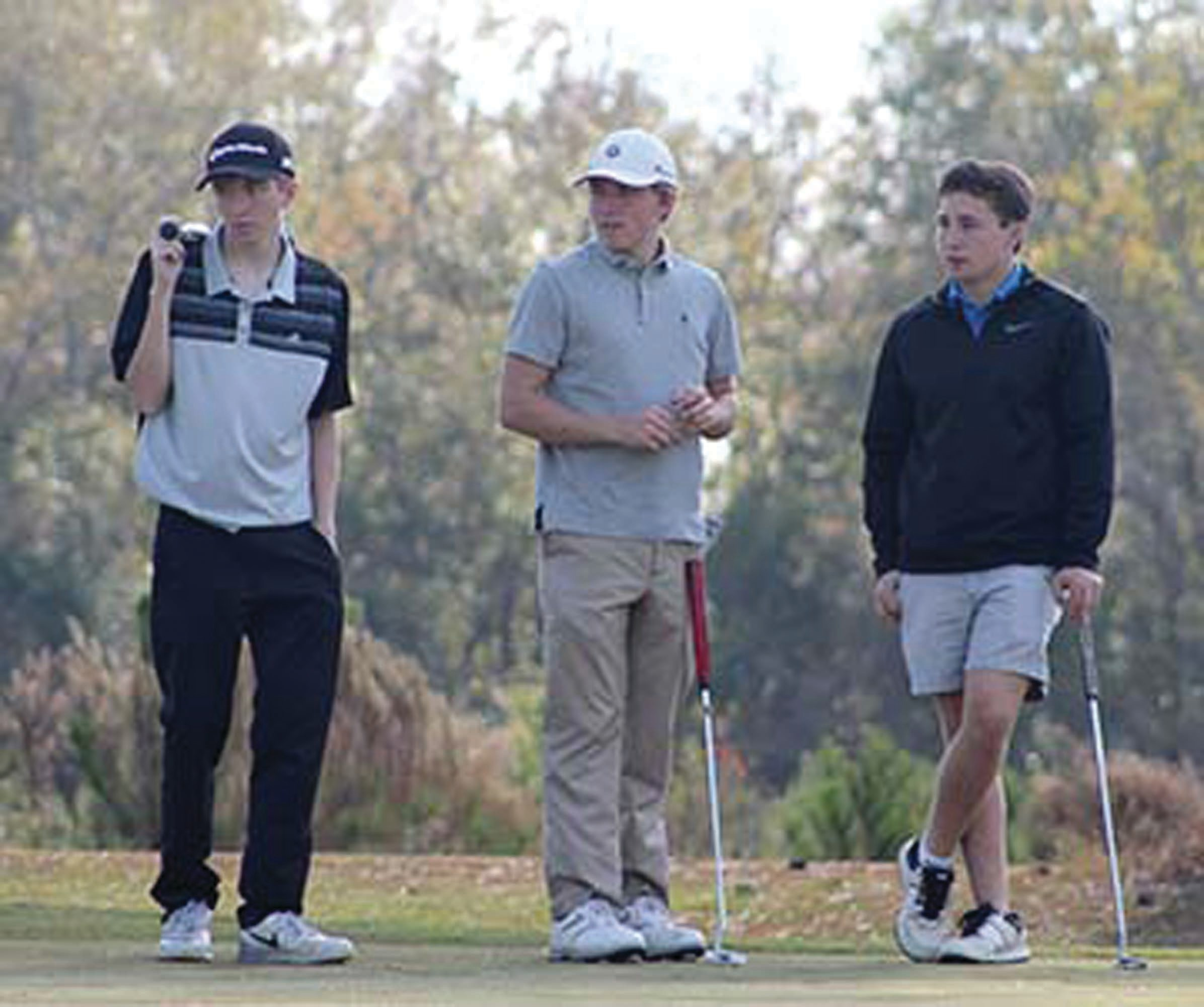 Hunter White, Robert Dykes and Jacob Richburg, all 17, await their turn to play during the Clarendon County Youth Golf Tournament held Saturday at Shannon Greens Golf Course,  The threesome finished the tournament in first place.