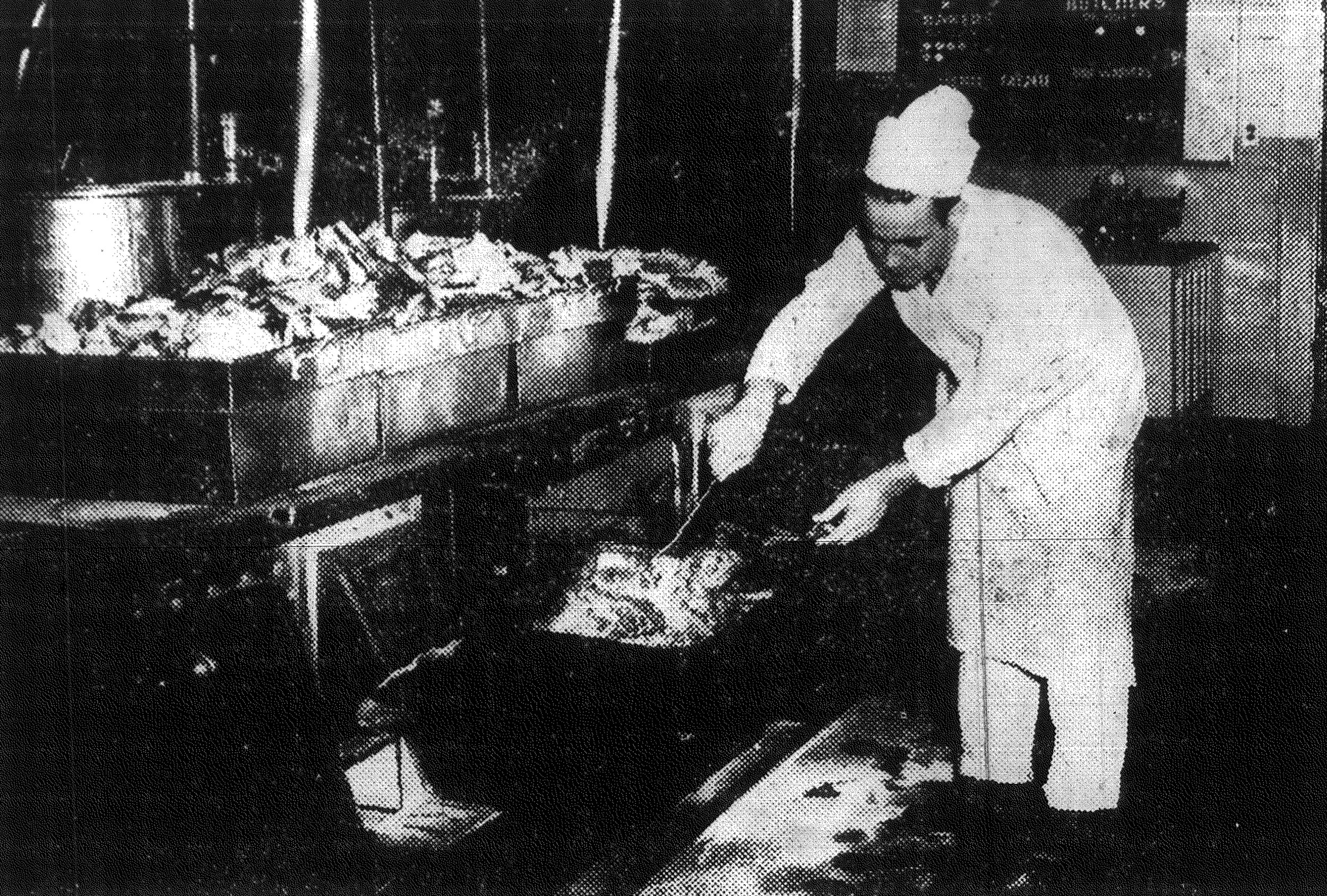 The last of 200 turkeys comes out the oven at the consolidated mess on Thanksgiving morning. The enlisted men consumed more than 3,000 pounds of turkey during the feast.