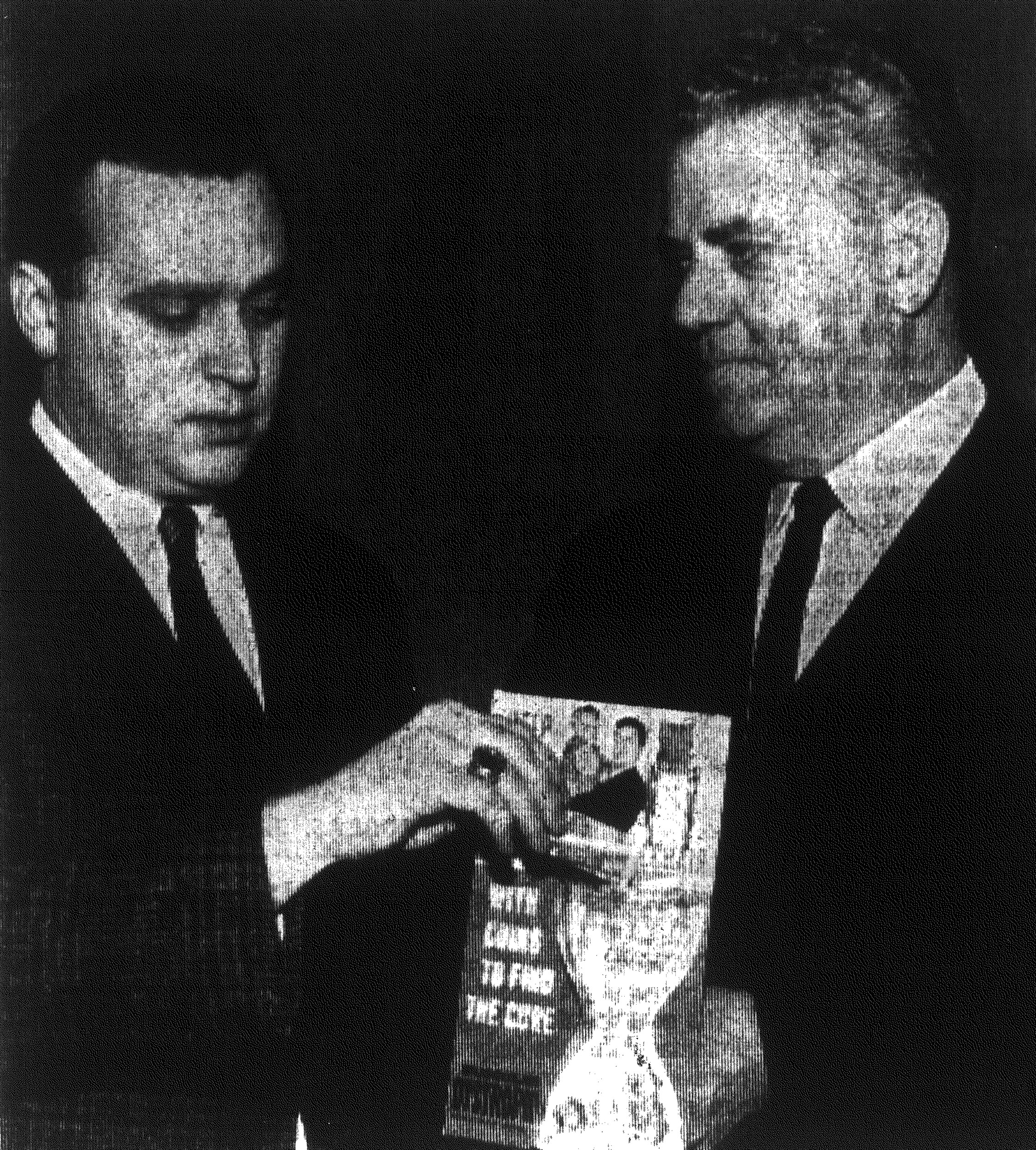 1968 - J.F. McLeod Jr., left, chairman of the local Muscular Dystrophy drive, puts the first donation in one of the cannisters that will be placed in downtown stores. With him is Chester A. Lawson, canister chairman for the campaign.