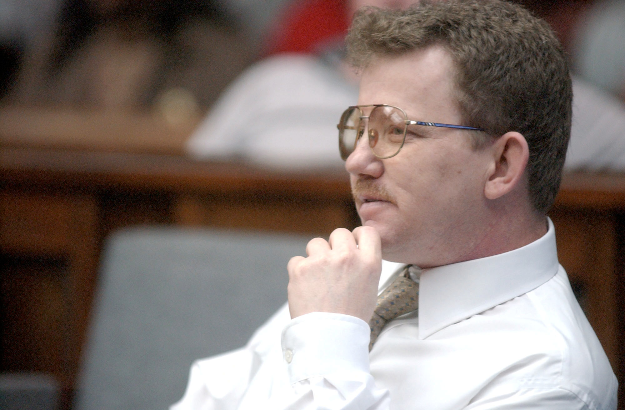 Bobby Wayne Stone listens as Third Circuit Judge Howard P. King talks with prospective jurors during his resentencing trial in 2005 at Sumter County Courthouse. Stone was convicted of the murder of Sgt. Charles Kubala.