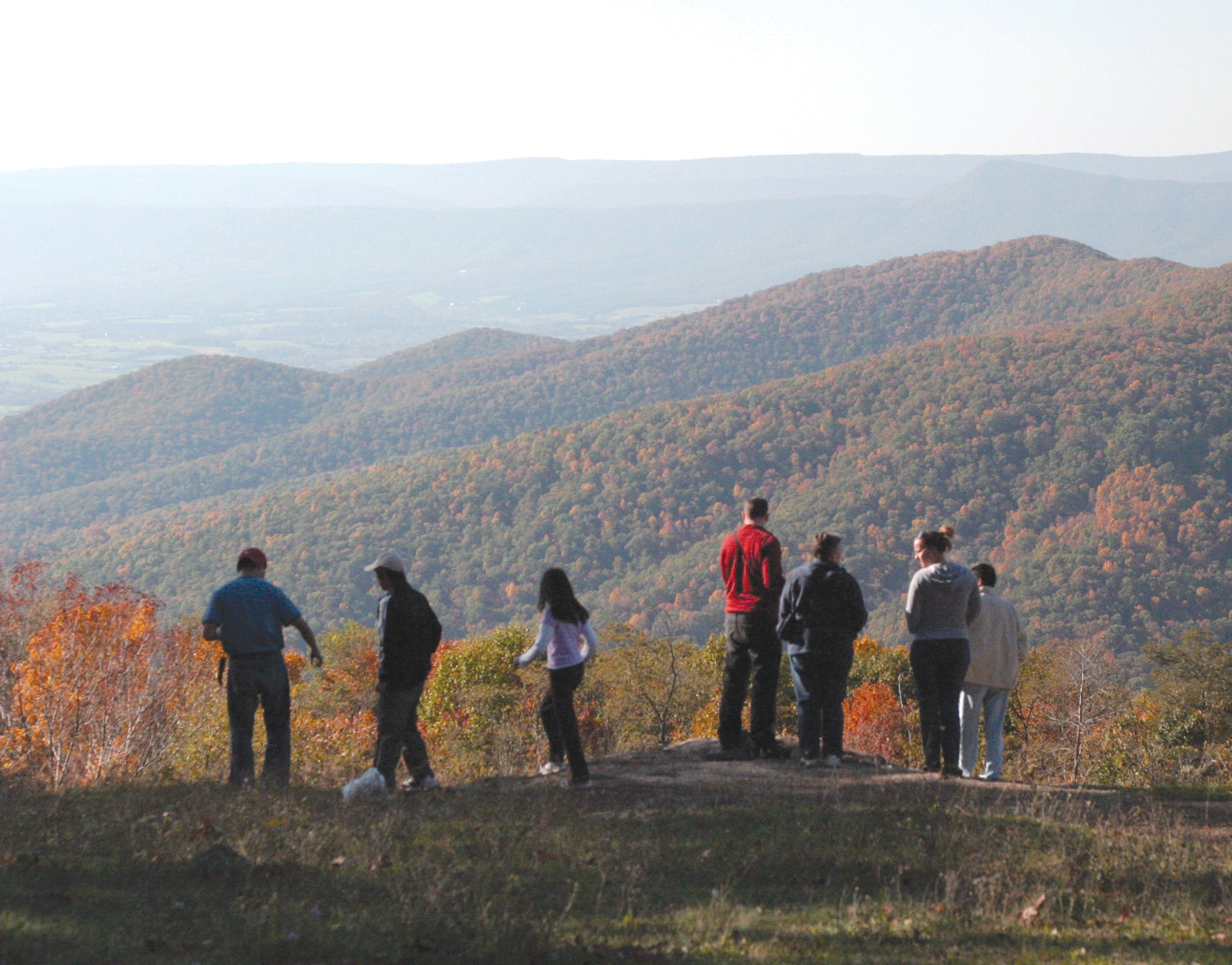 Viewers look out on autumn foliage from an overlook in Shenandoah National Park south of Front Royal, Virginia, in 2001. A group of state attorneys general on Wednesday urged the National Park Service to scrap its proposal to more than double the entrance fee at 17 popular national parks.