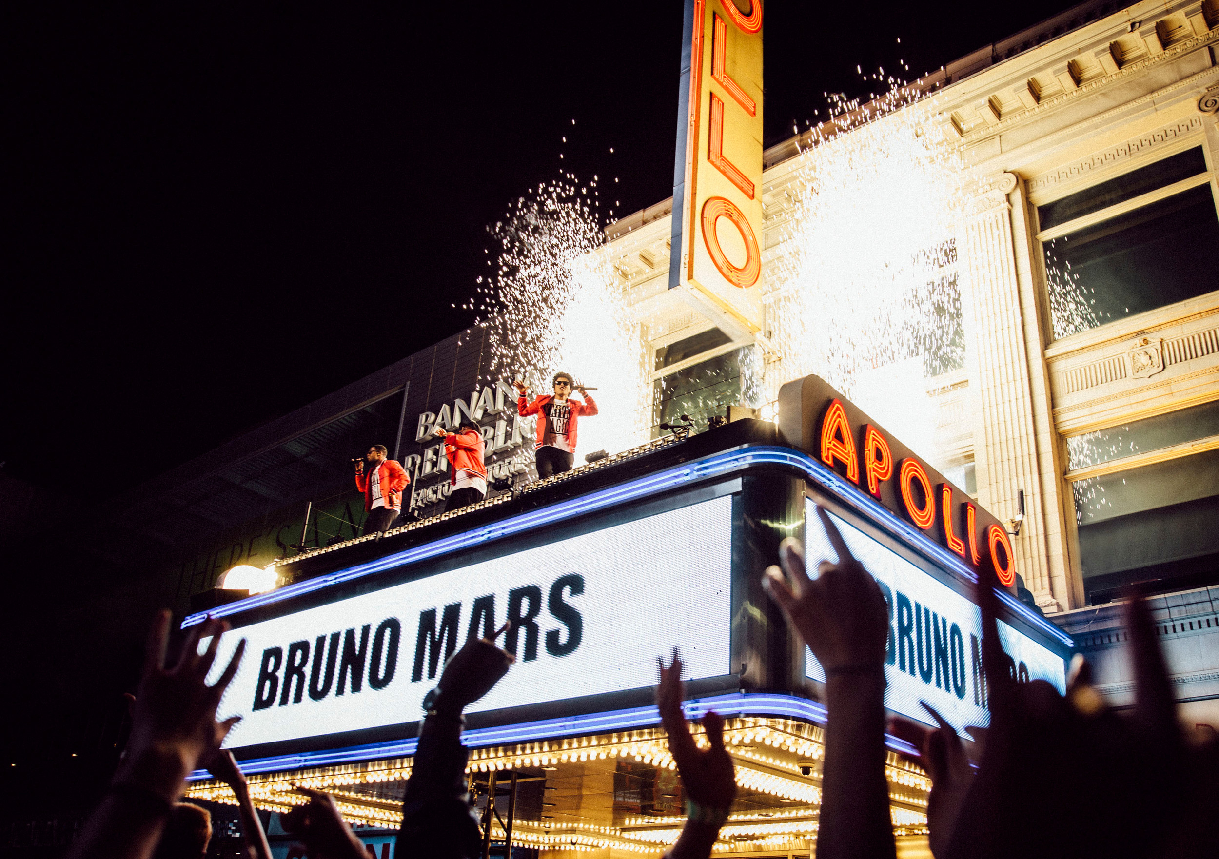 Bruno Mars performs atop the Apollo Theater marquee in New York City.