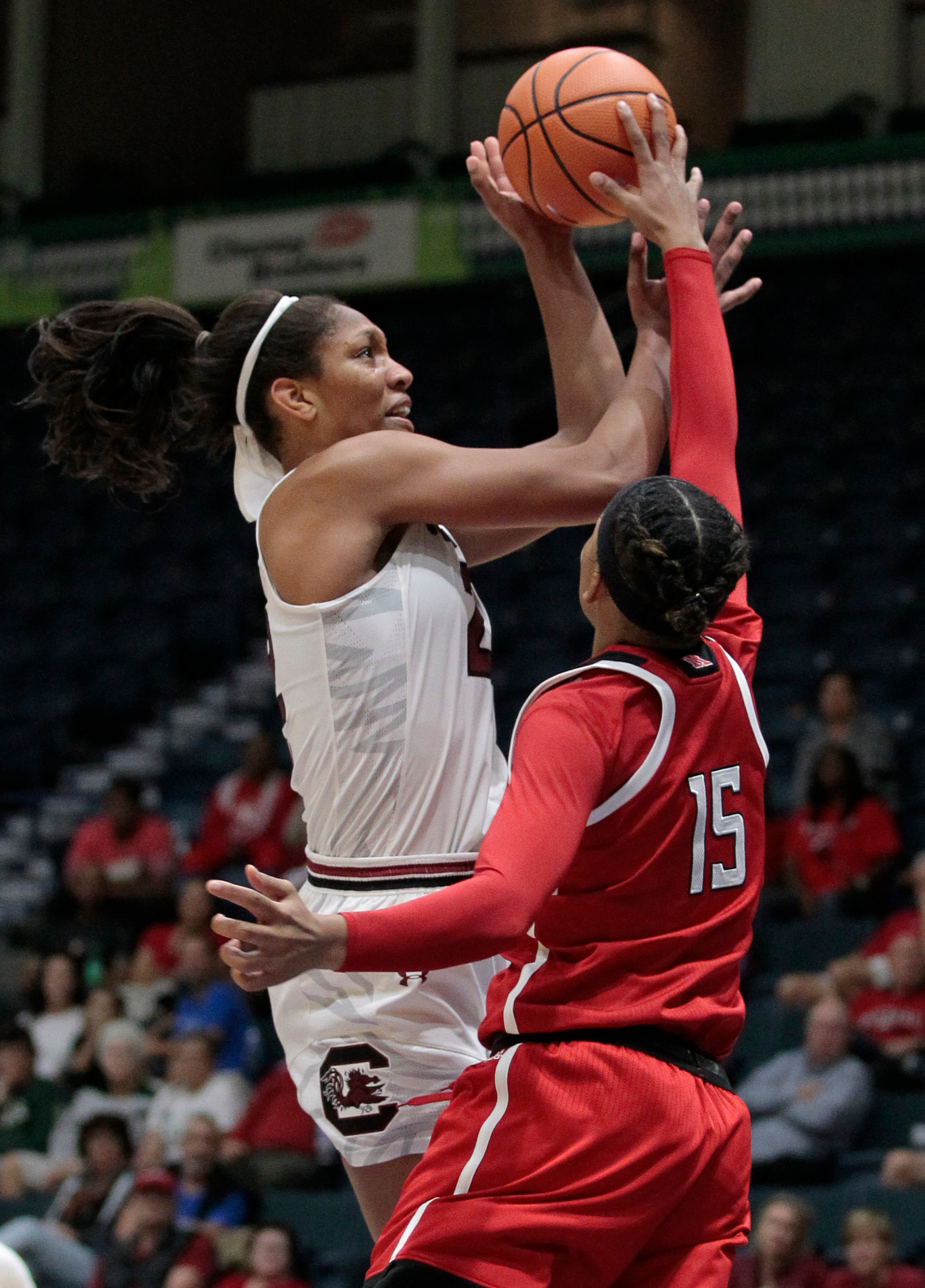 South Carolina's A'ja Wilson, left, goes up for a shot in the Gamecocks' 78-68 victory over Rutgers on Friday in the Gulf Coast Showcase in Estero, Fla. Wilson scored 33 points.