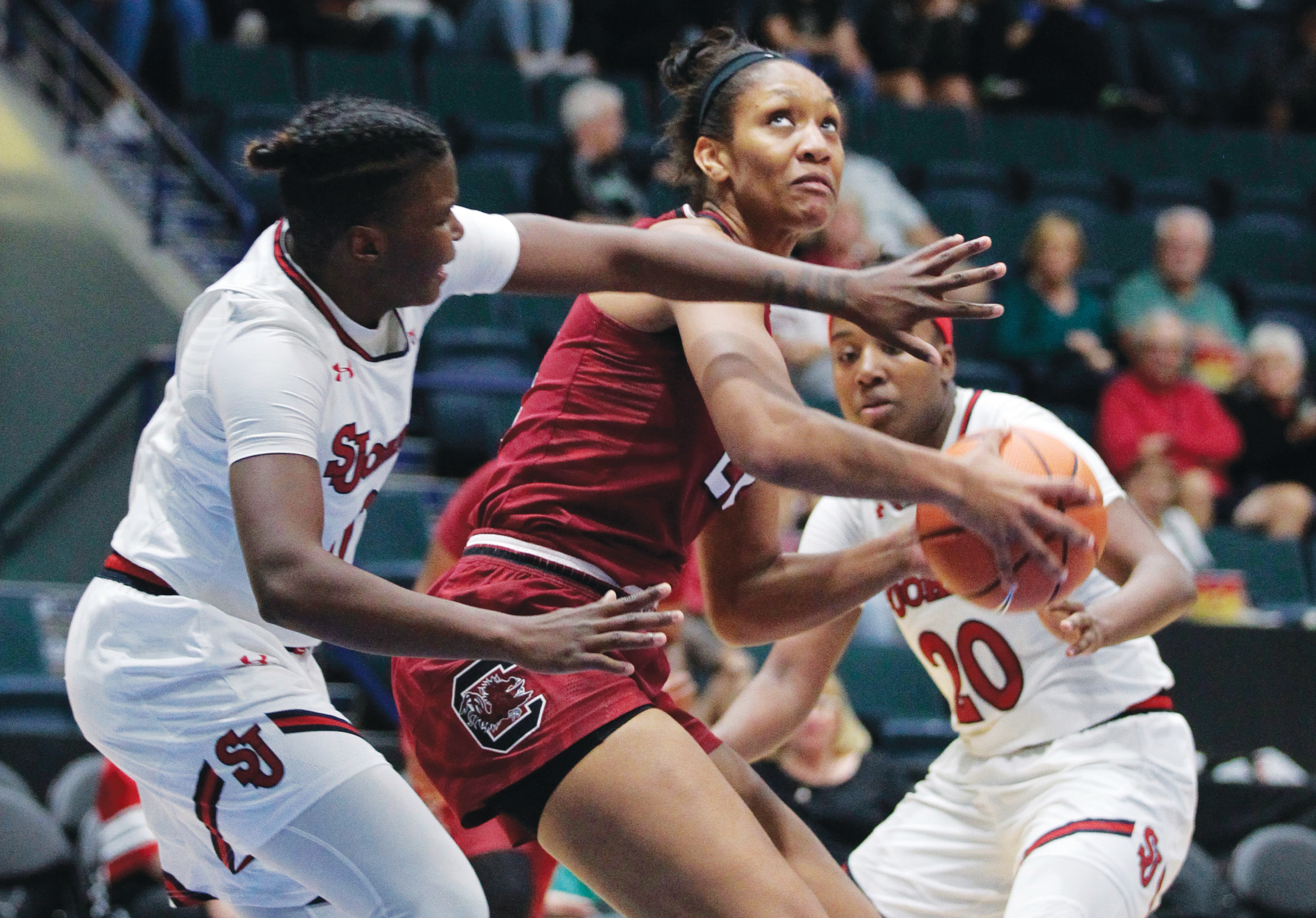 South Carolina's A'ja Wilson, center, prepares to shoot against St. John's Alisha Kebbe, left, and Akina Wellere (20) during the Gamecocks' 76-58 victory in the Gulf Coast Showcase on Saturday in Estero, Florida.