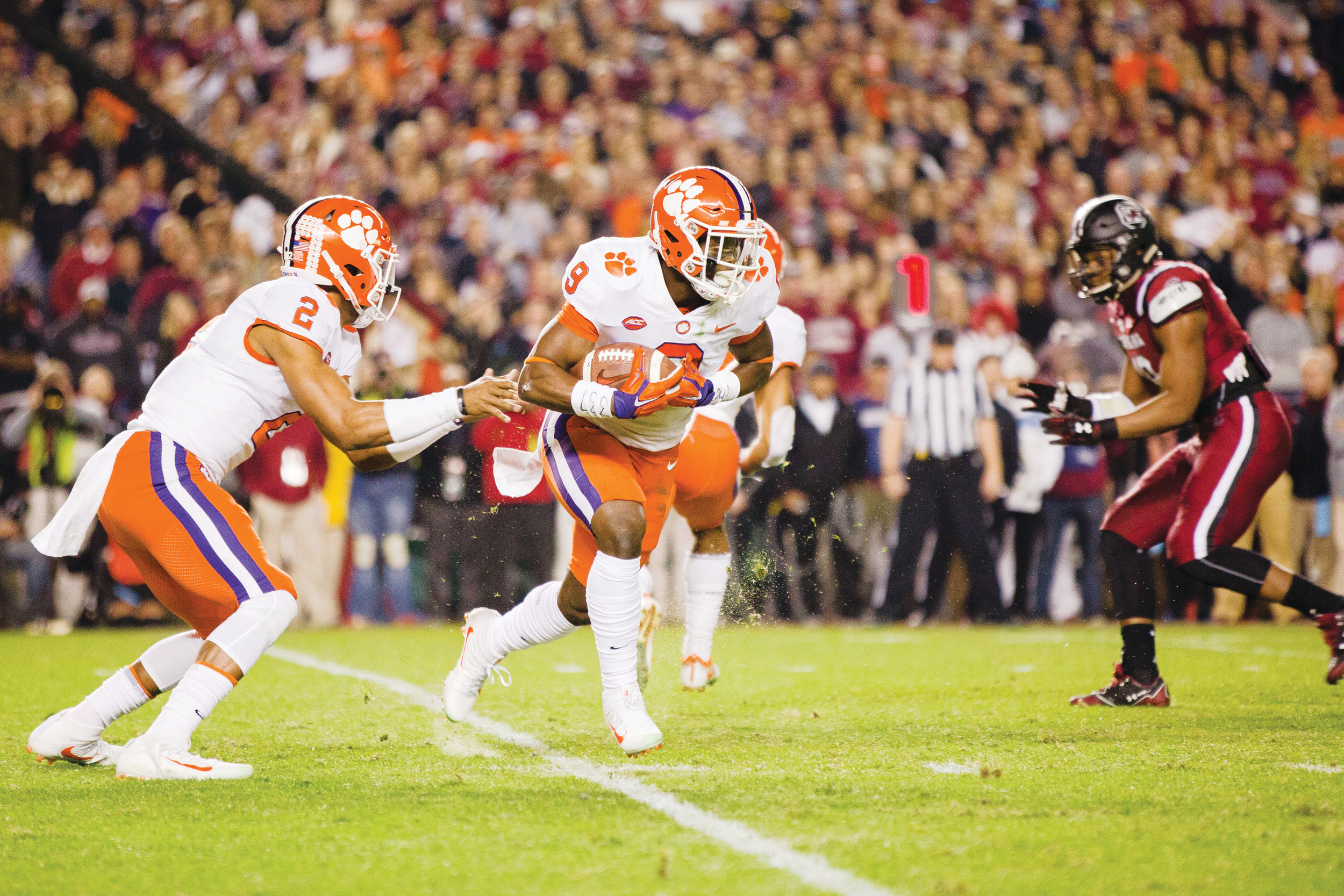 Clemson running back Travis Etienne (9) takes a handoff from quarterback Kelly Bryant (2) during the Tigers' 34-10 victory over South Carolina on Saturday at Williams-Brice Stadium in Columbia.