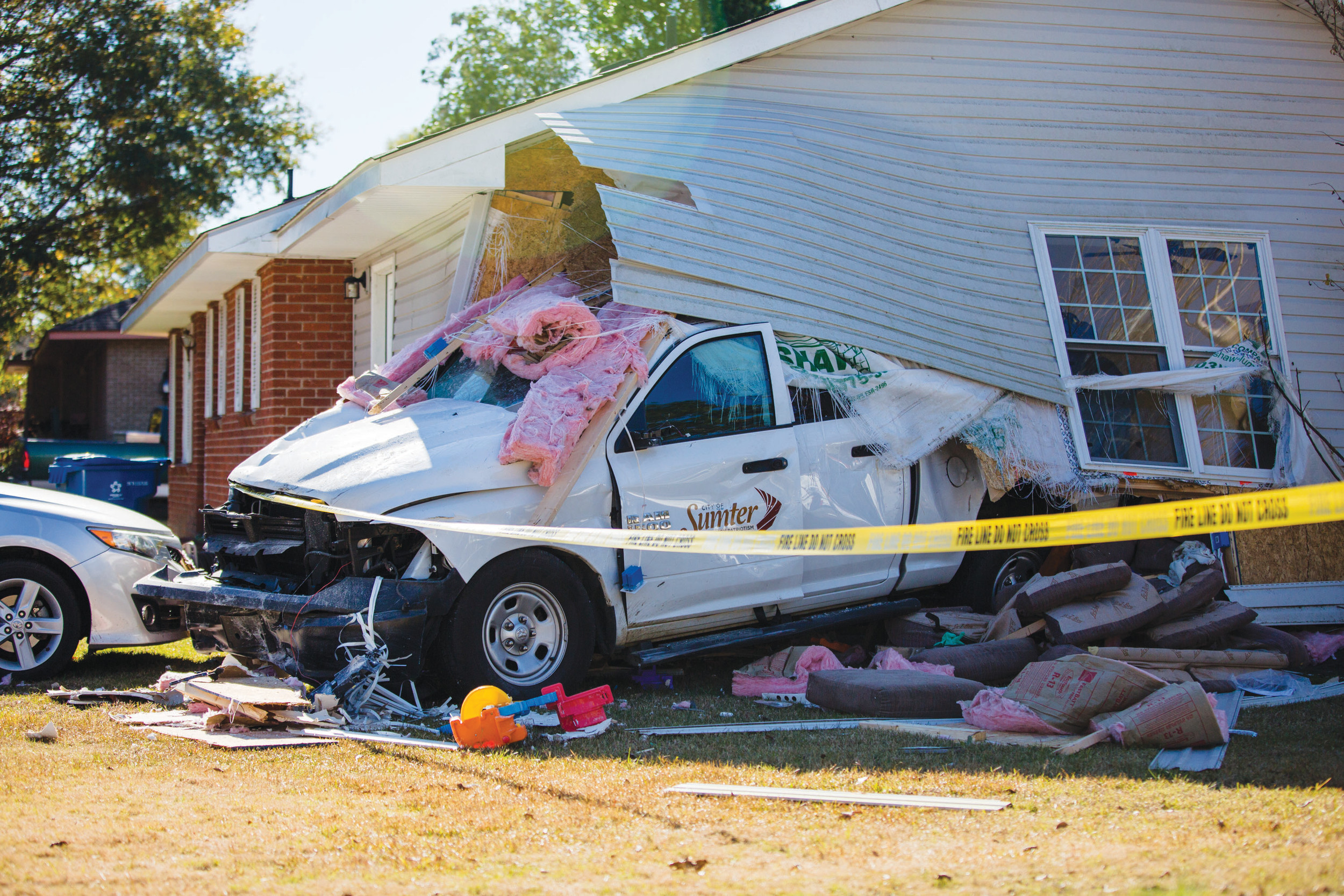 A City of Sumter truck slammed through a house Monday morning, seriously injuring a 2-year-old child.