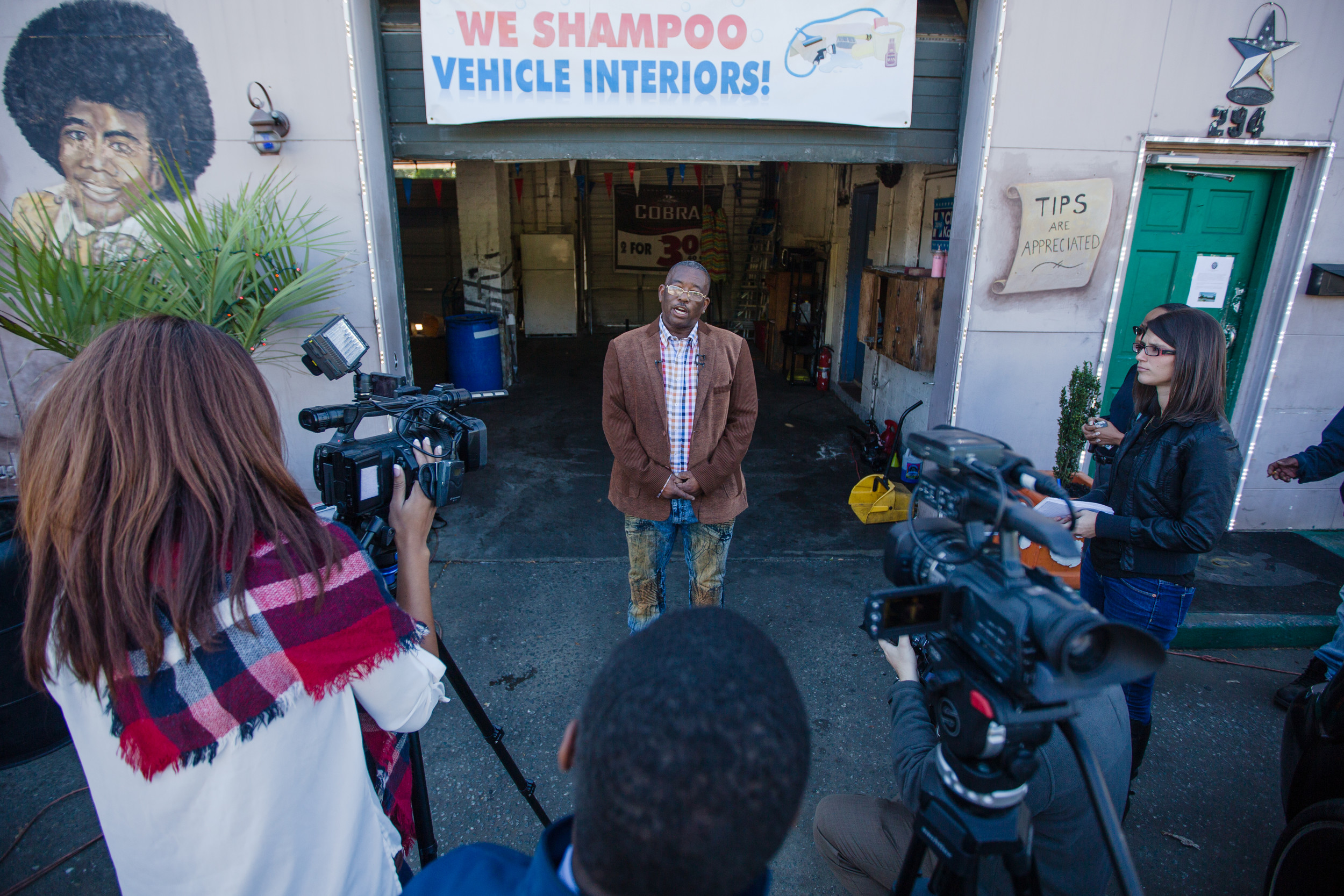 Kenny Black, a friend of Patel, speaks with media outside of his car wash business on Broad Street.