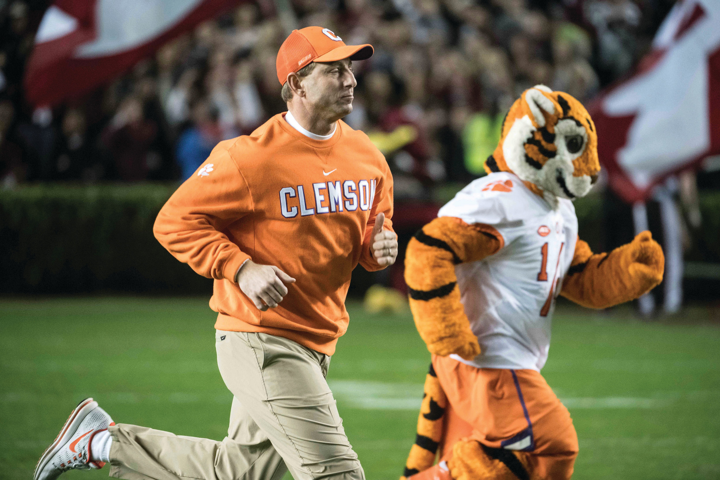 THE ASSOCIATED PRESSClemson head coach Dabo Swinney runs onto the field before an NCAA college football game Saturday in Columbia. Clemson defeated South Carolina 34-10.