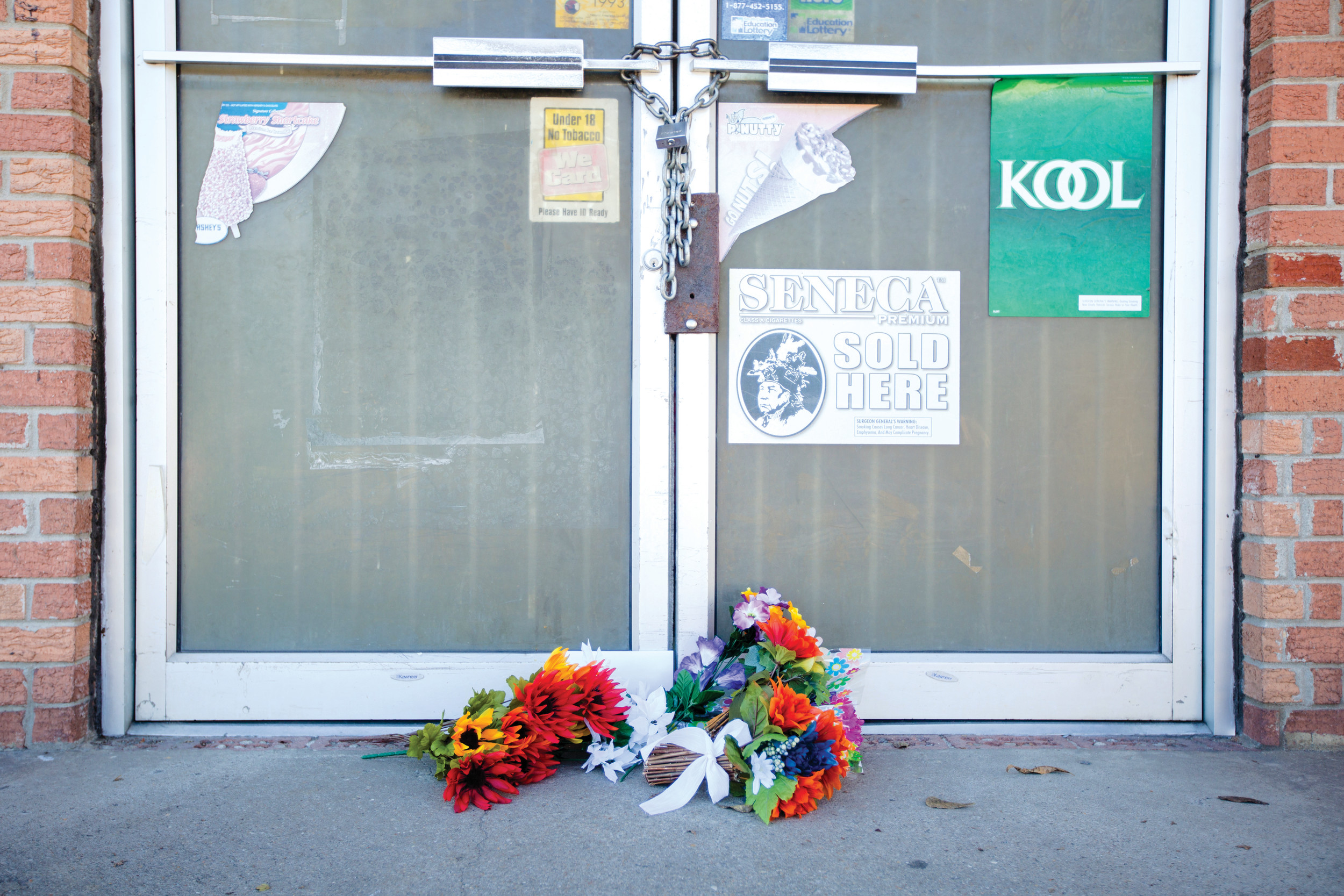 Flowers at the door to Save-Mart grocery store on Manning Street.